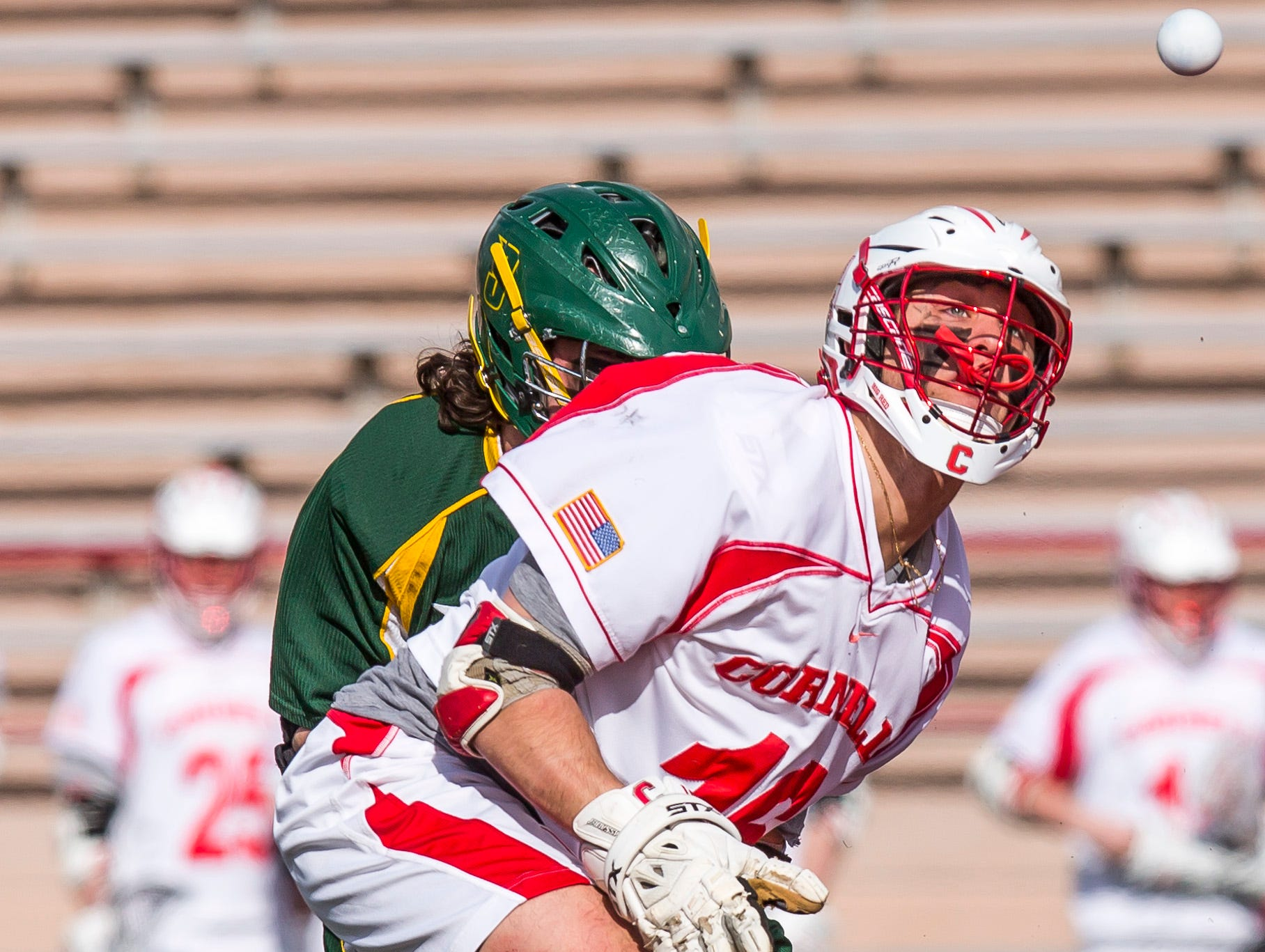 2013: Cornell junior Doug Tesoriero eyes the ball during during a faceoff in Cornell's 17 to 9 victory over Siena College Tuesday afternoon at Cornell's Schoellkopf Field.