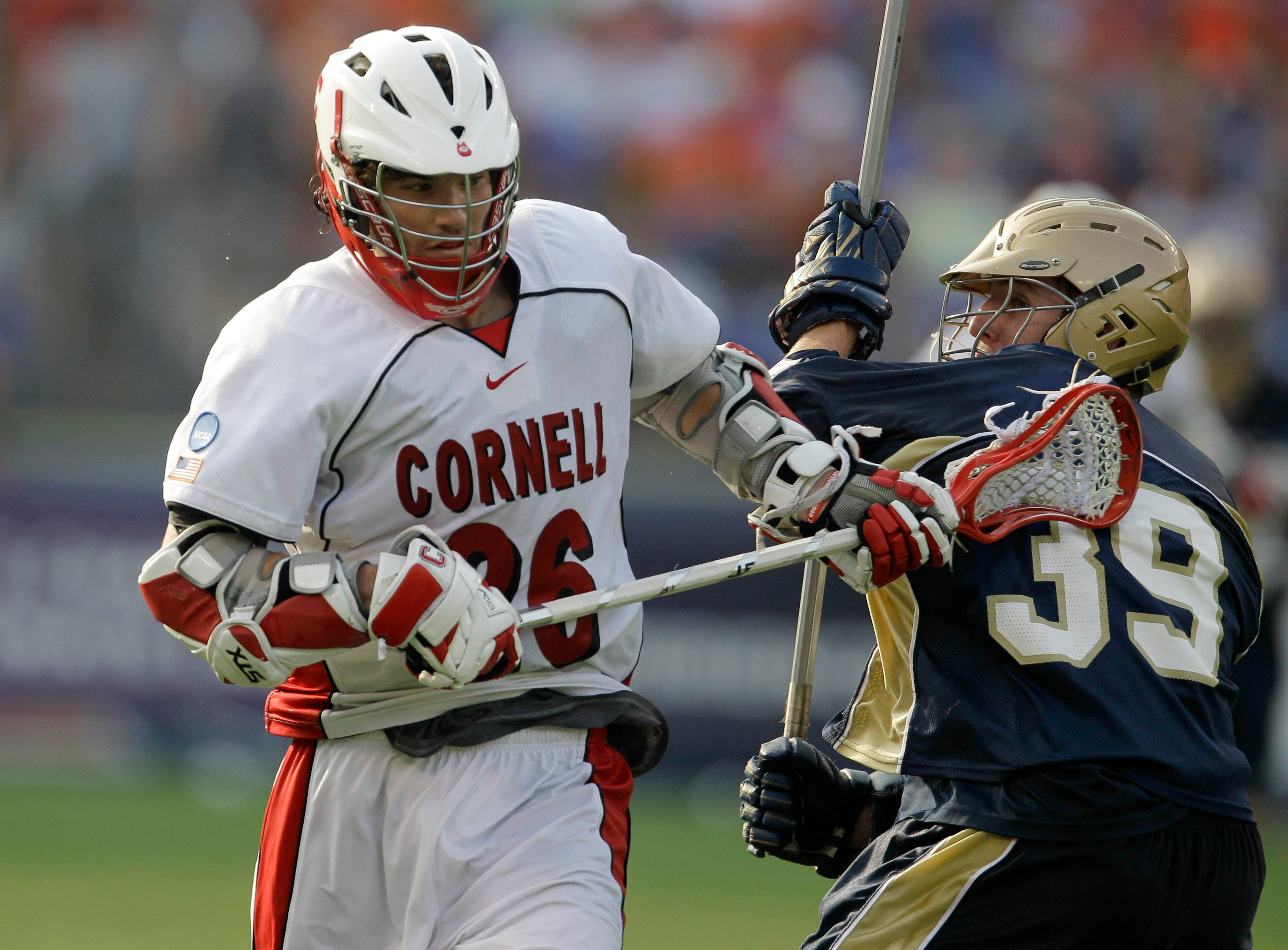 Cornell's TJ Weyl, left, looses control of the ball while being defended by Notre Dame's Kevin Randall (39) during the second half of the NCAA Men's Final Four semifinal lacrosse game, Saturday, May 29, 2010, in Baltimore. Notre Dame won 12-7.