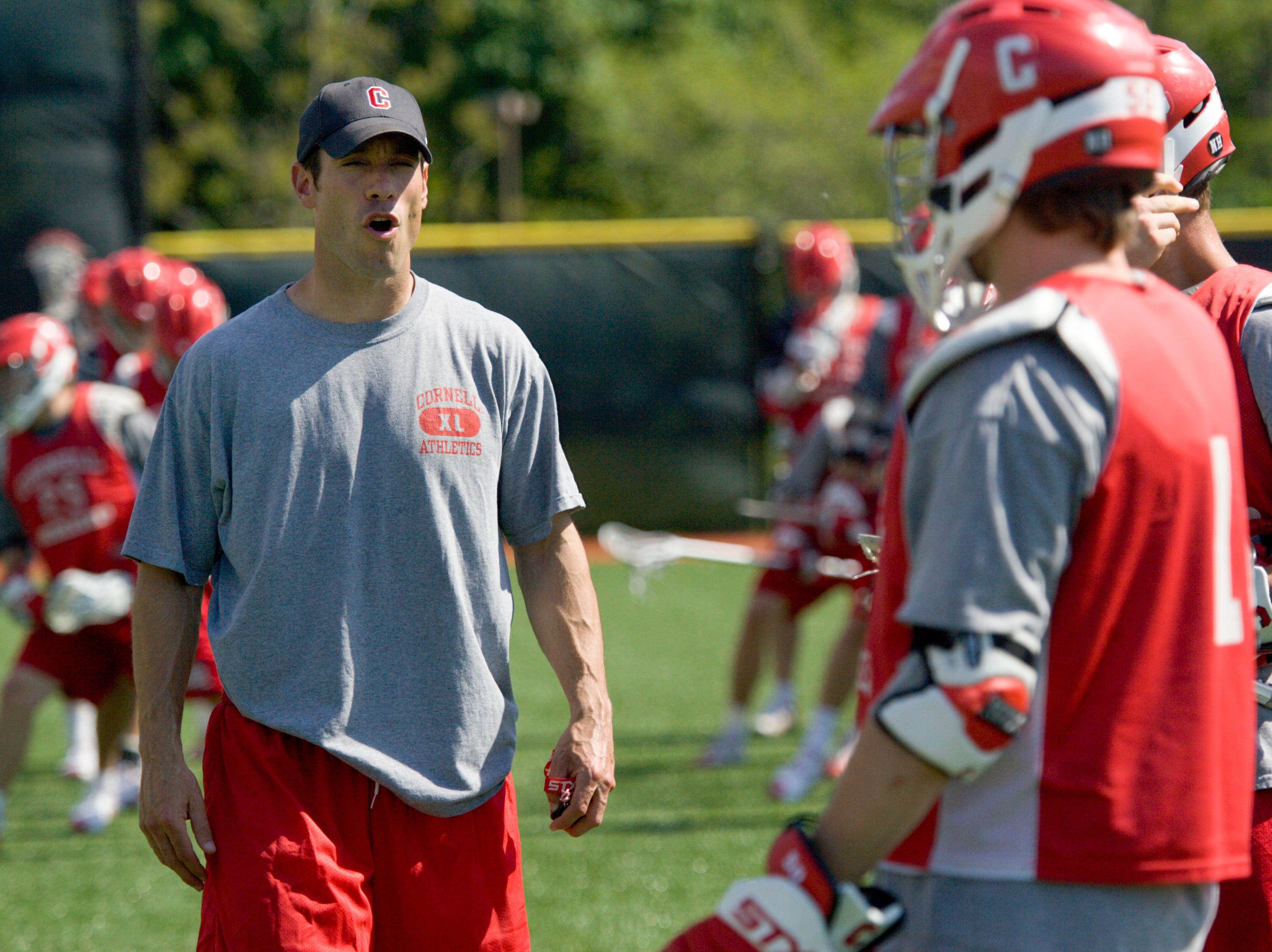 2009: Cornell Men's Lacrosse Coach Jeff Tambroni coaches Wednesday during practice at Cornell University.
