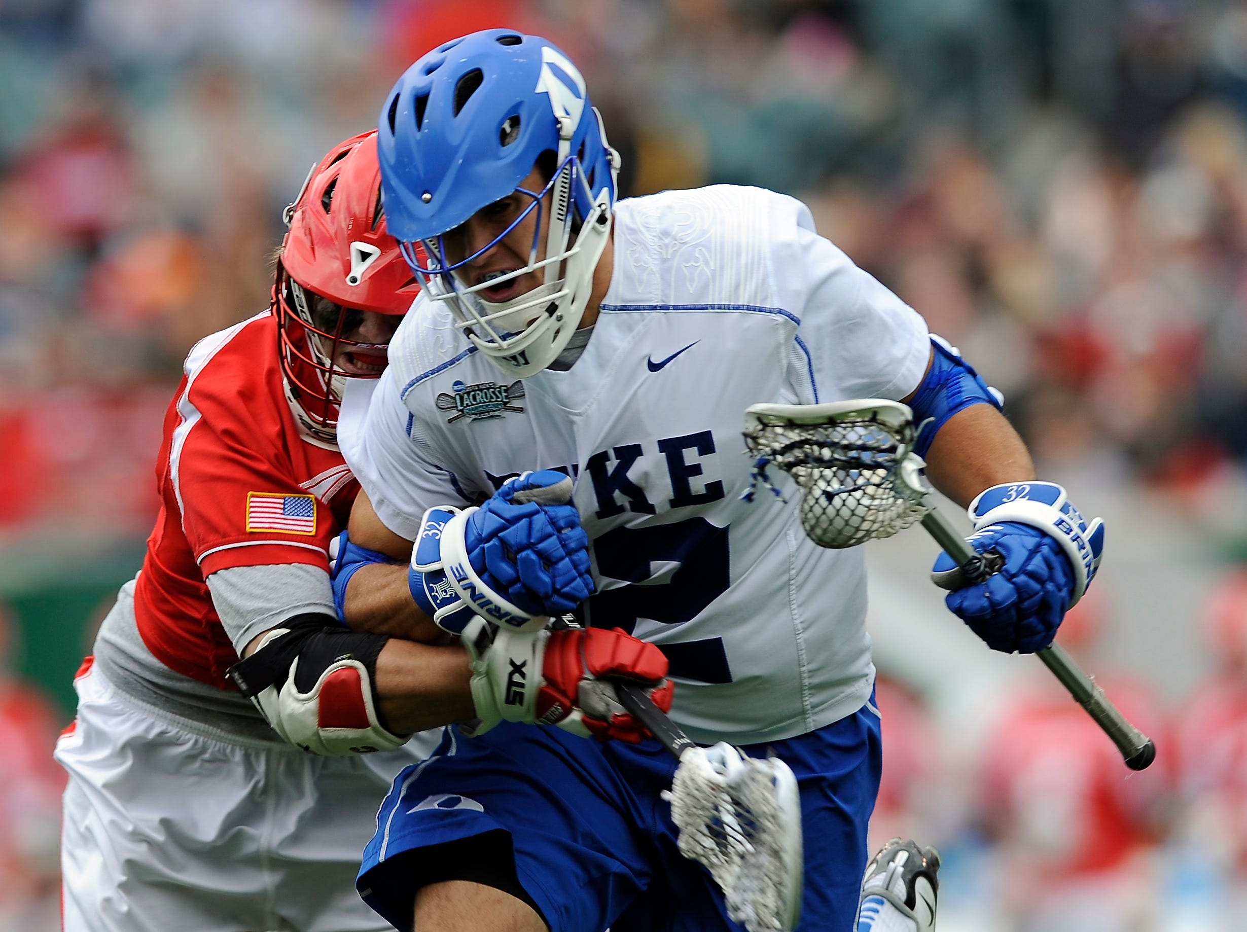 Duke's Greg DeLuca, right, drives past Cornell's Connor Buczek during the first half of an NCAA division 1 semifinal lacrosse game on Saturday, May 25, 2013, in Philadelphia.
