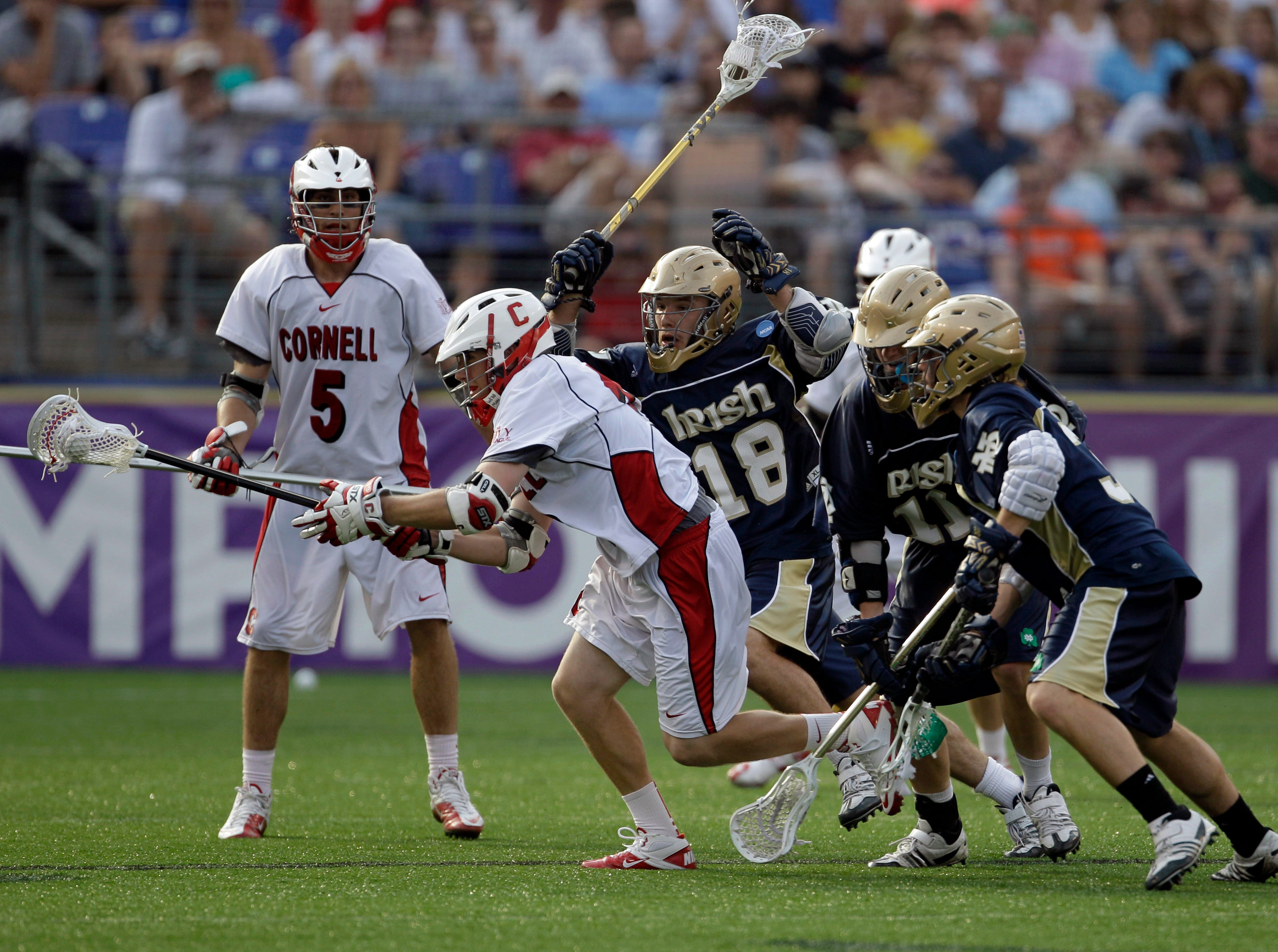 Cornell's Andrew MacDonald is defended Notre Dame players Sean Rogers, (18) Neal Hicks, middle, and Nicholas Beattie, right, during the second half of the NCAA Men's Final Four semifinal lacrosse game, Saturday, May 29, 2010, in Baltimore. Notre Dame won 12-7. At left is Cornell's Pierce Derkac.
