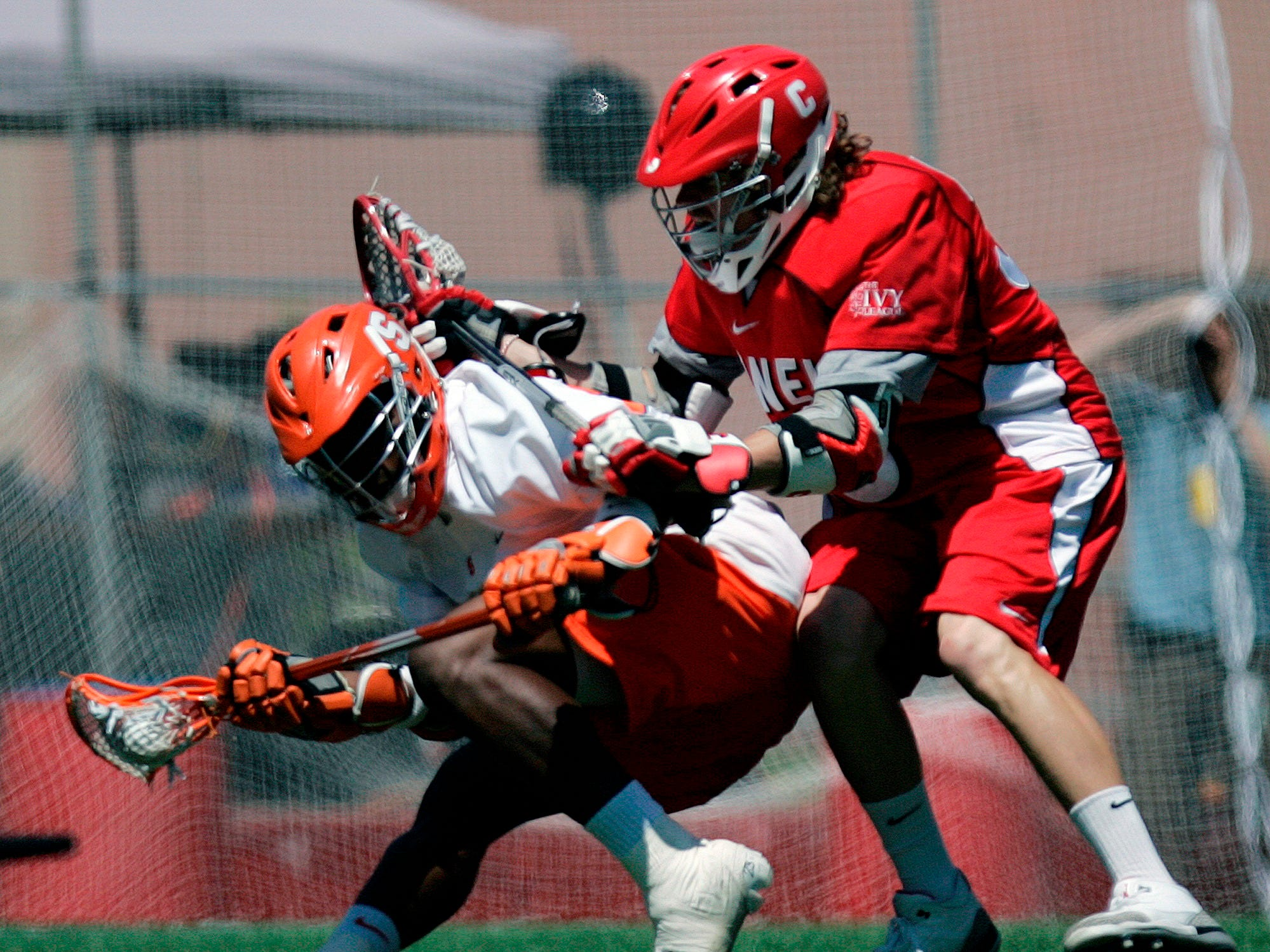 Cornell's Jonathan Thomson, right, checks Syracuse's Jovan Miller in the second quarter of an NCAA Division 1 Men's lacrosse championship game in Foxborough, Mass., Monday, May 25, 2009.