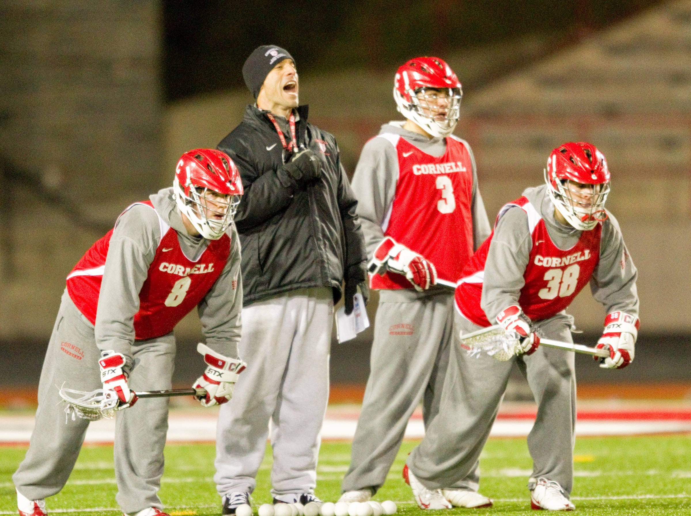 2010: First Cornell Lacrosse practice. February 1, 2010. Pictured: Coach Jeff Tambroni conducts drills with players.