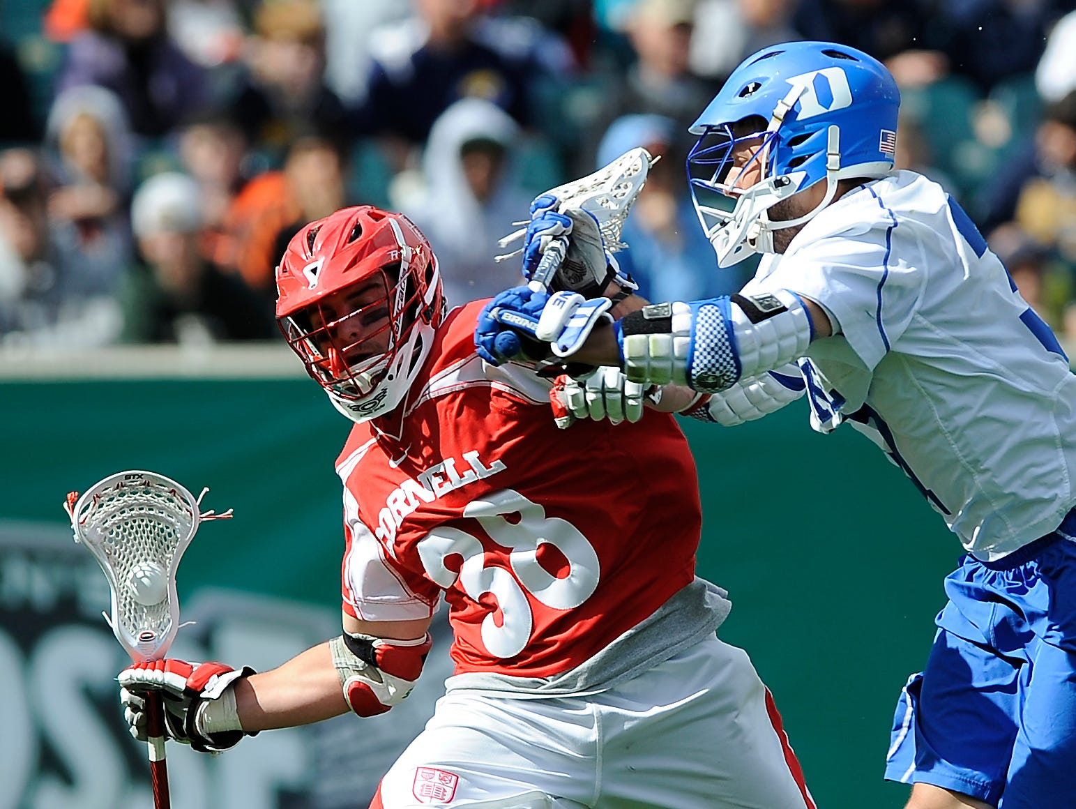 Duke's Brendan Fowler, right, defends against Cornell's Jordan Stevens (35) who brings the ball upfield during the second half of an NCAA college Division 1 semifinal lacrosse game on Saturday, May 25, 2013, in Philadelphia. Duke won 16-14.
