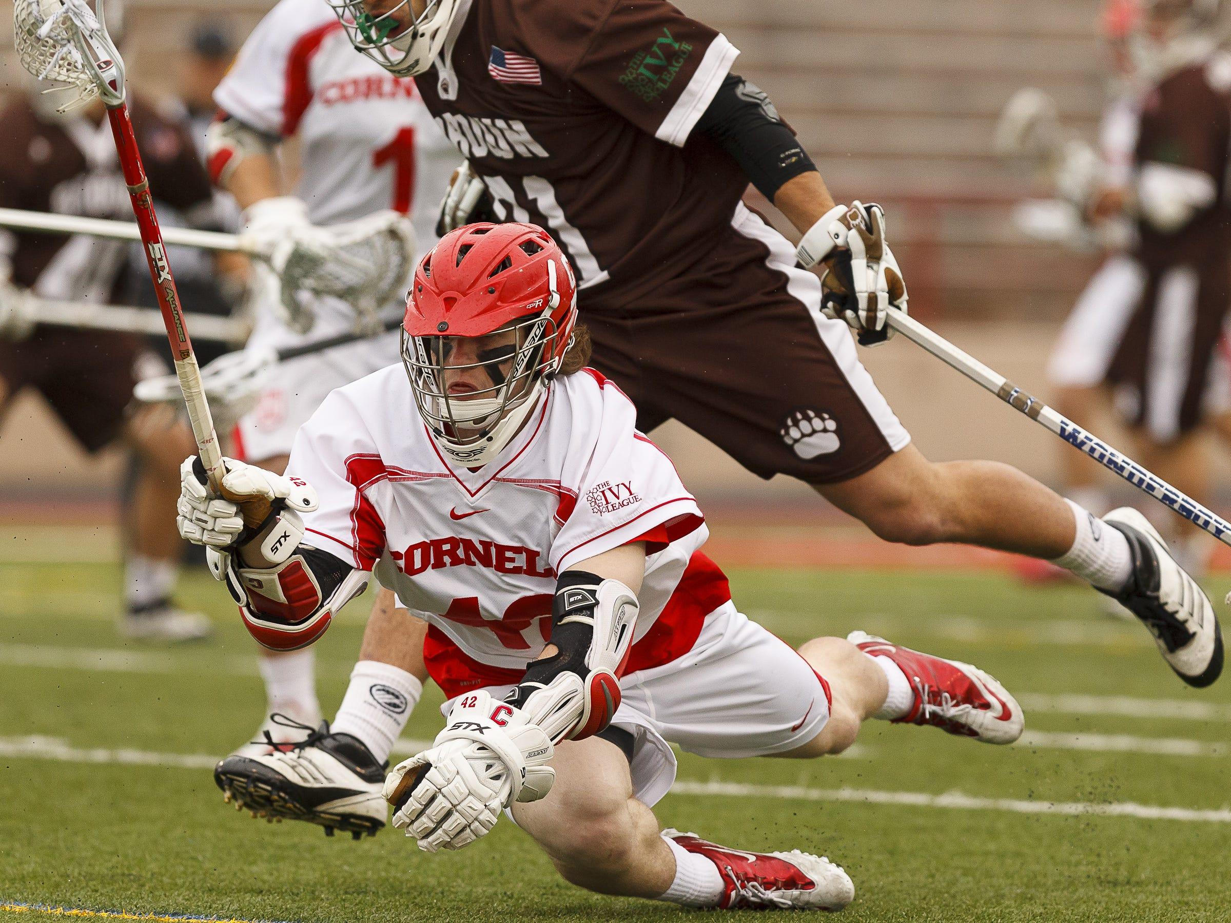 2012: Cornell junior Connor English reaches for a ground ball Saturday in College Mens Lacrosse. The two teams faced each other at Schoellkopf  field. Brown defeated Cornell with 4.7 seconds remaining in the game. The final score was Cornell 9 and Brown 10.