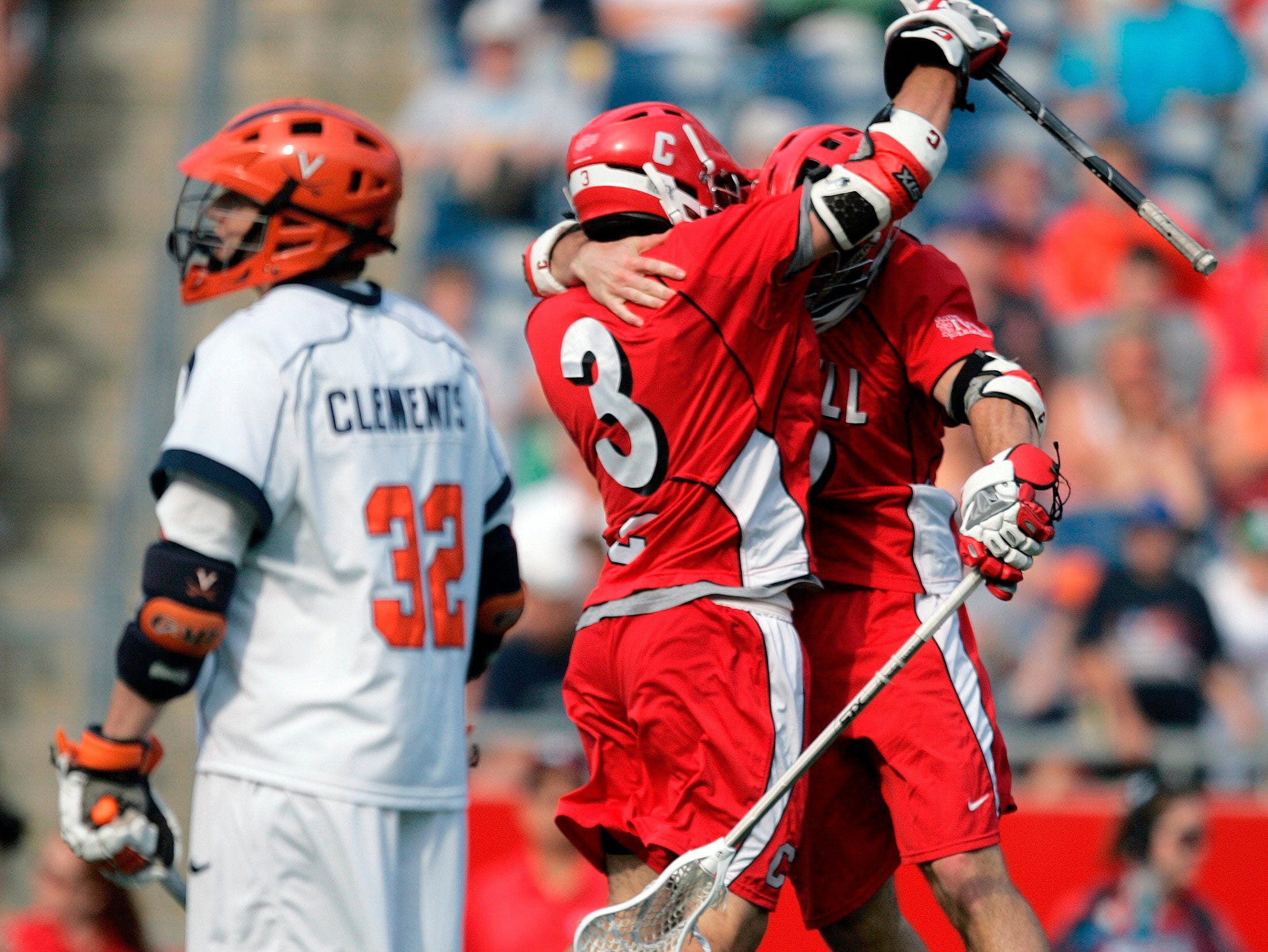 Cornell's Max Seibald, right, celebrates his goal with teammate Rob Pannell (3) as Virginia's Chris Clements (32) looks away in the fourth quarter of an NCAA Division 1 men's lacrosse semifinal game in Foxborough, Mass., Saturday, May 23, 2009. Cornell won 15-6.