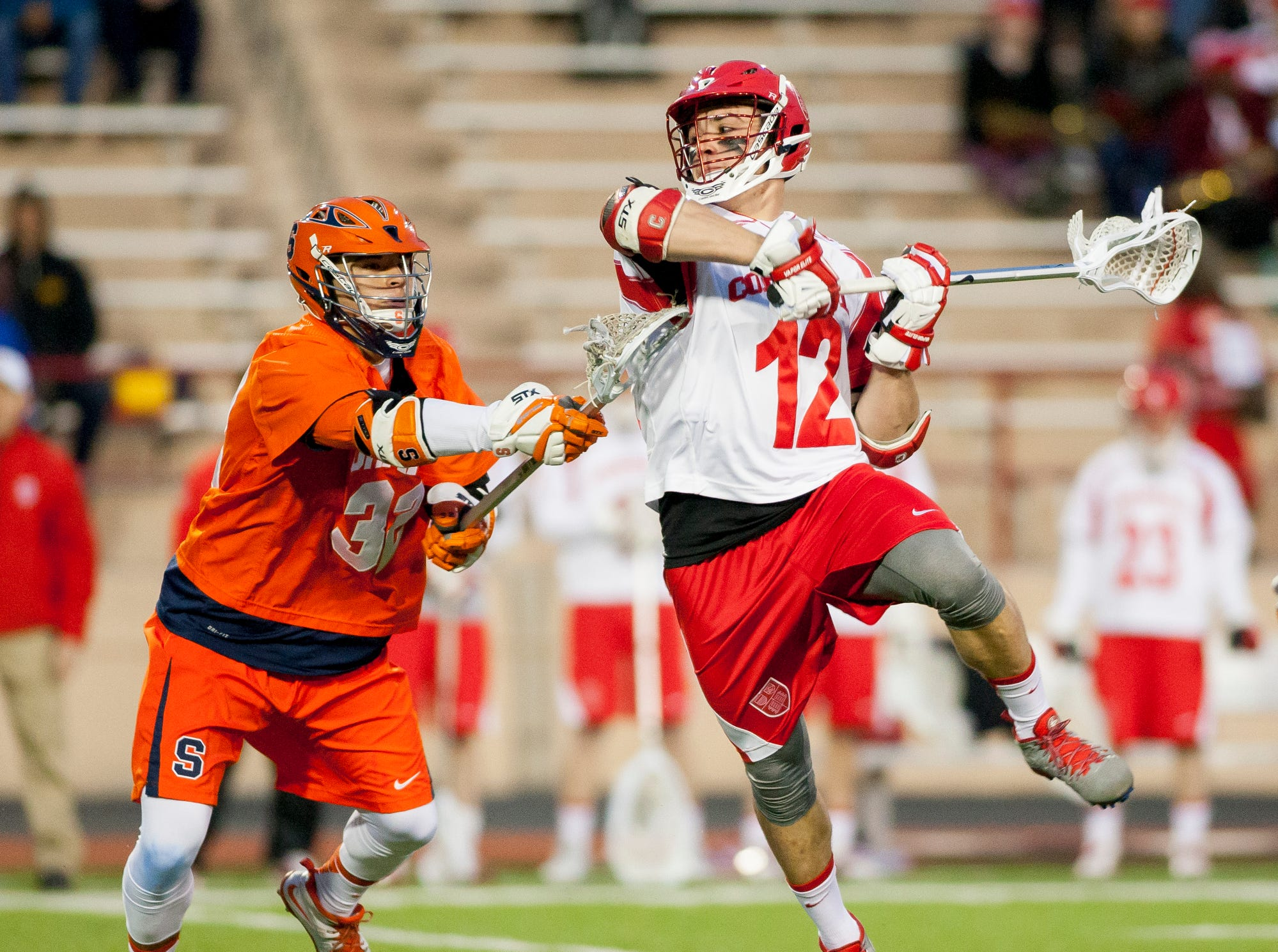 2014: Syracuse's Tom Grimm, left, defends as Cornell's Joe Paoletta winds up to shoot and score Cornell's fifth goal during the first half of their game Tuesday evening at Schoellkopf Field in Ithaca.