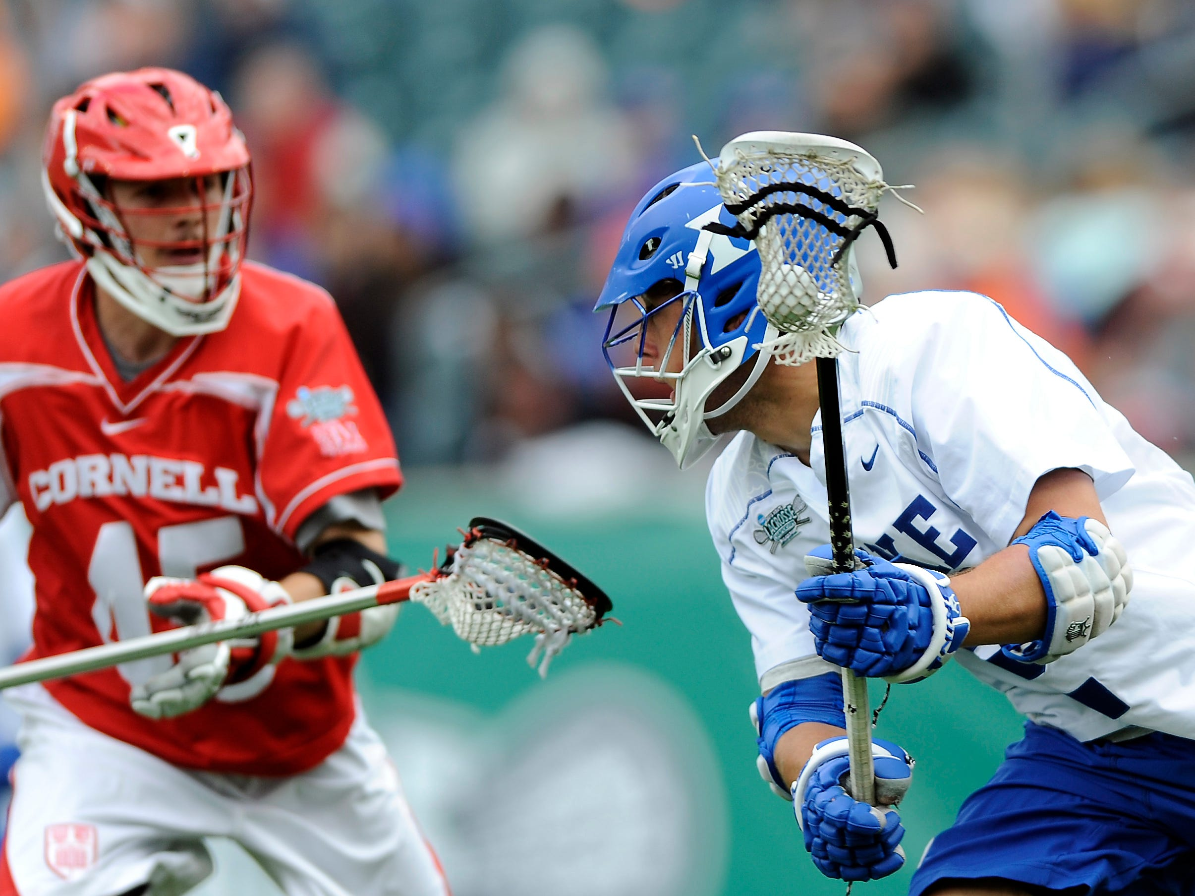 Duke's David Lawson, right, brings the ball past Cornell's Jason Noble (45) during the second half of an NCAA college Division 1 semifinal lacrosse game on Saturday, May 25, 2013, in Philadelphia. Duke won 16-14.