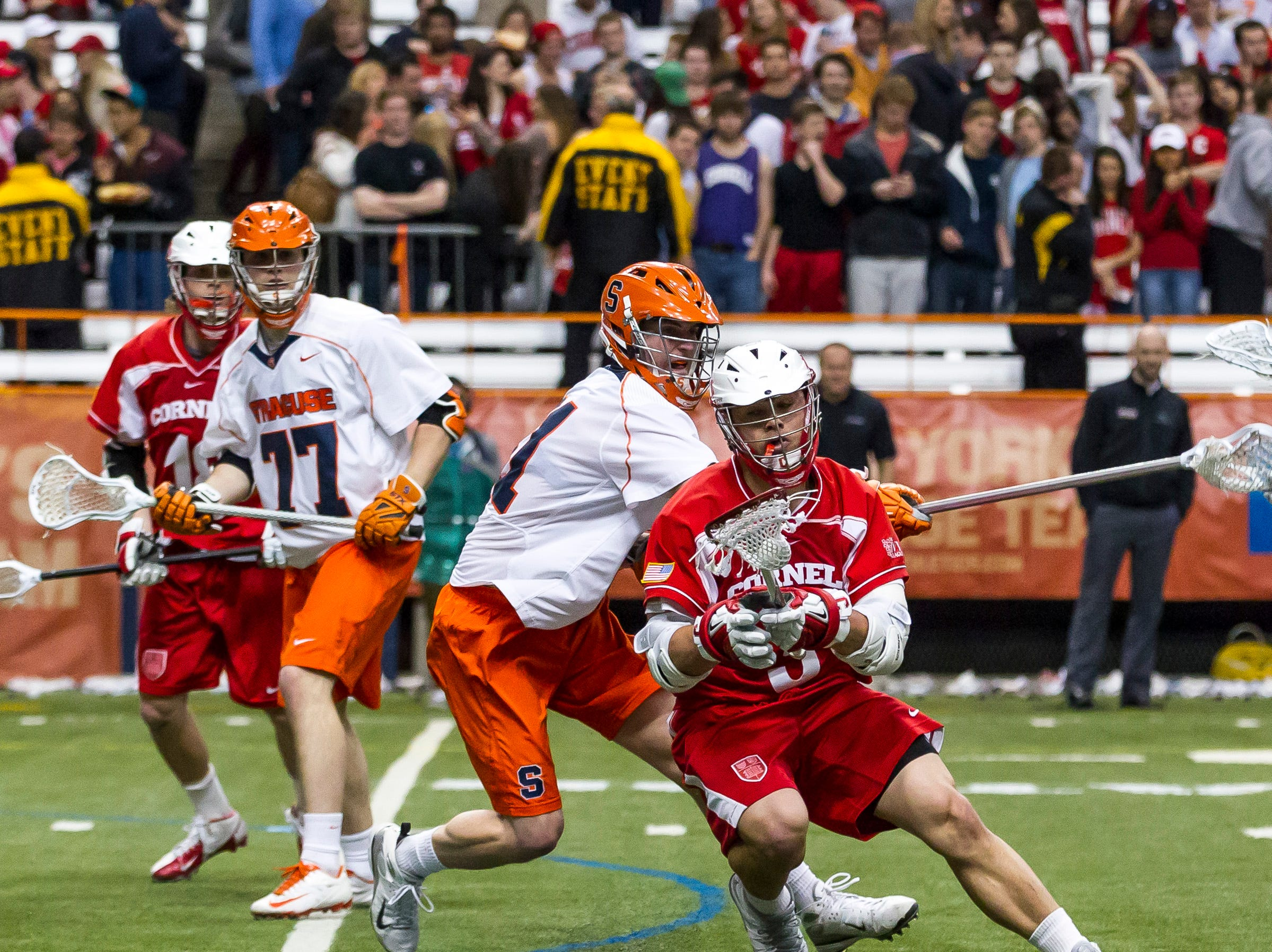 2013: Cornell senior Rob Pannell evades Syracuse junior David Hamlin during the first half as both teams battled in college mens lacrosse Wednesday night in Syracuse University's Carrier Dome.