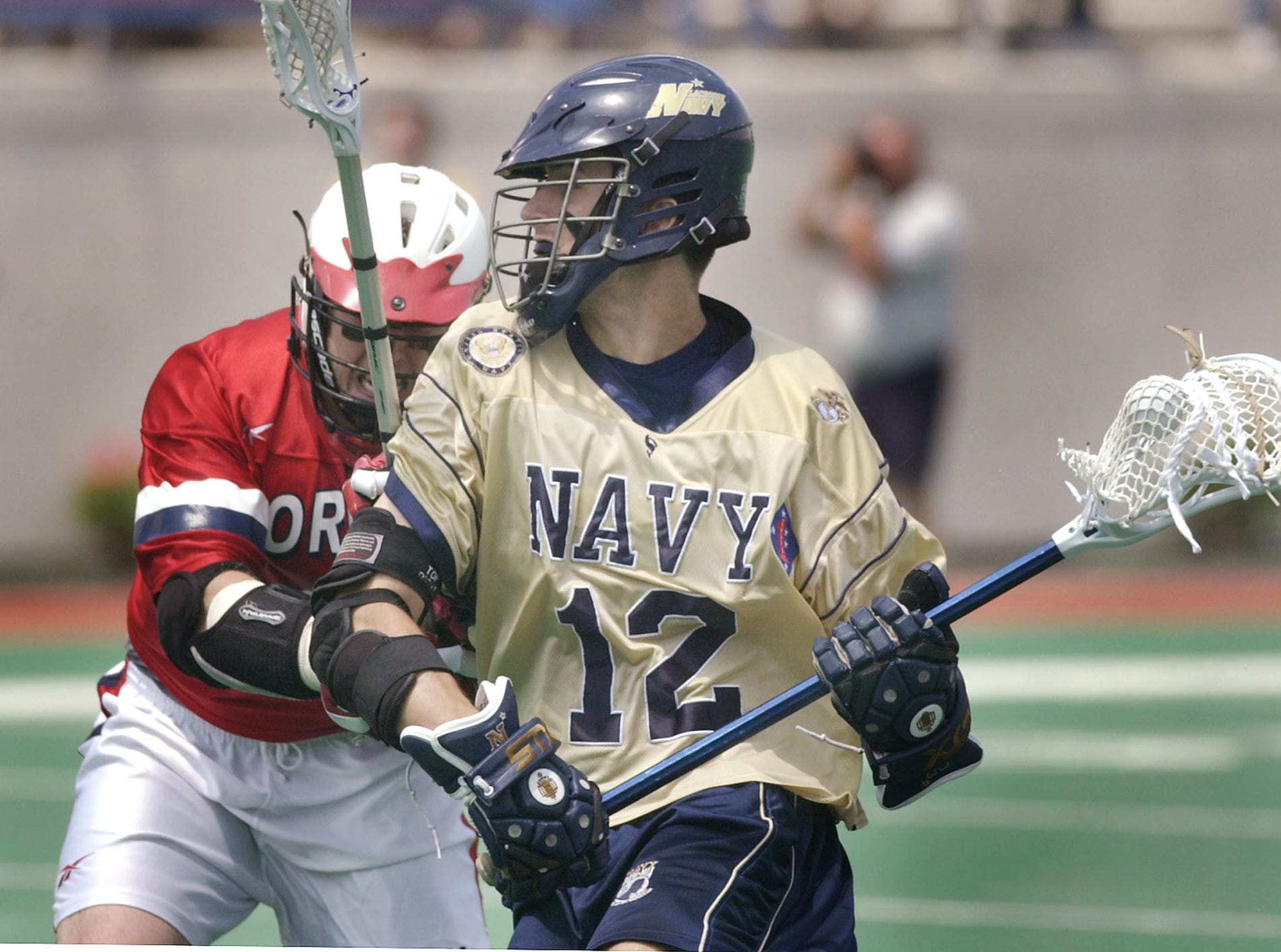 Navy's Graham Gill (12) drives against the Cornell defense during the second quarter of the NCAA Div. I Lacrosse Championship quarterfinals in Ithaca, N.Y., Sunday, May 23, 2004. Navy won, 6-5.