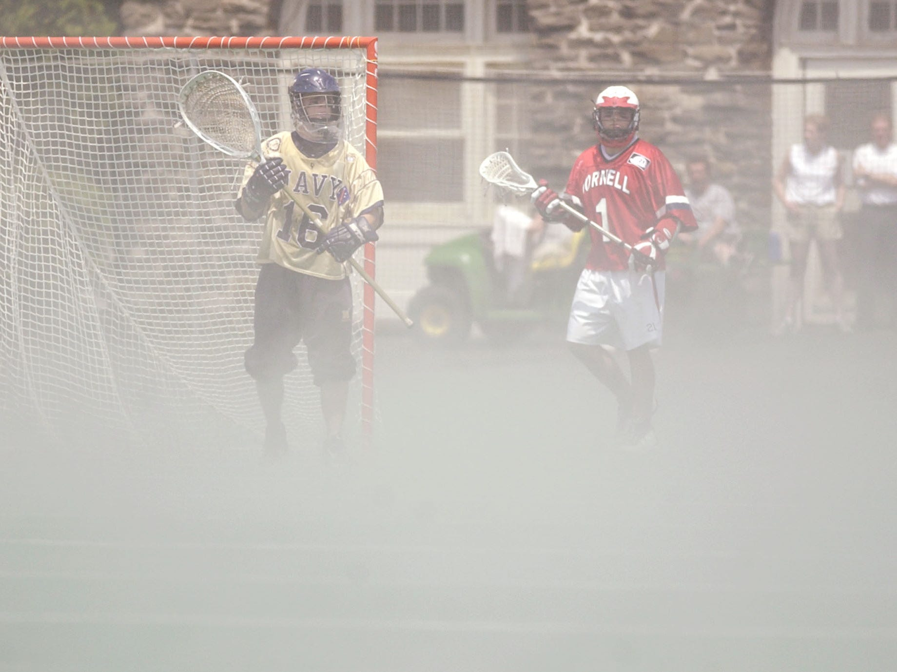 Navy goalie Matt Russell (16) and Cornell's Andrew Collins (1) watch the action as vapor rises from the field during the second quarter of the  NCAA Division I lacrosse championship quarterfinals in Ithaca, N.Y., Sunday, May 23, 2004. Navy won 6-5.