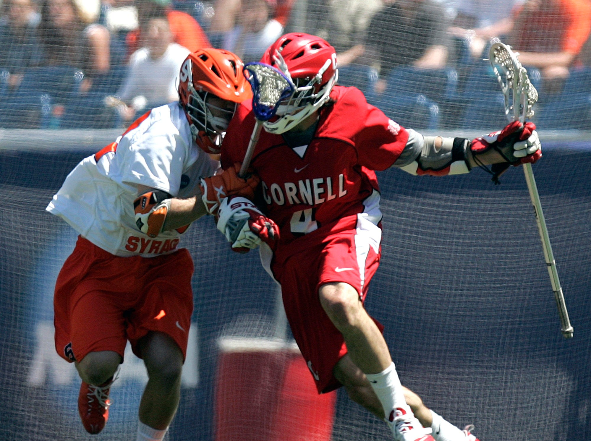 Syracuse's Tim Harder, left, and Cornell's Christopher Ritchie go head-to-head in the second quarter of an NCAA Division 1 Men's lacrosse championship game in Foxborough, Mass., Monday, May 25, 2009.