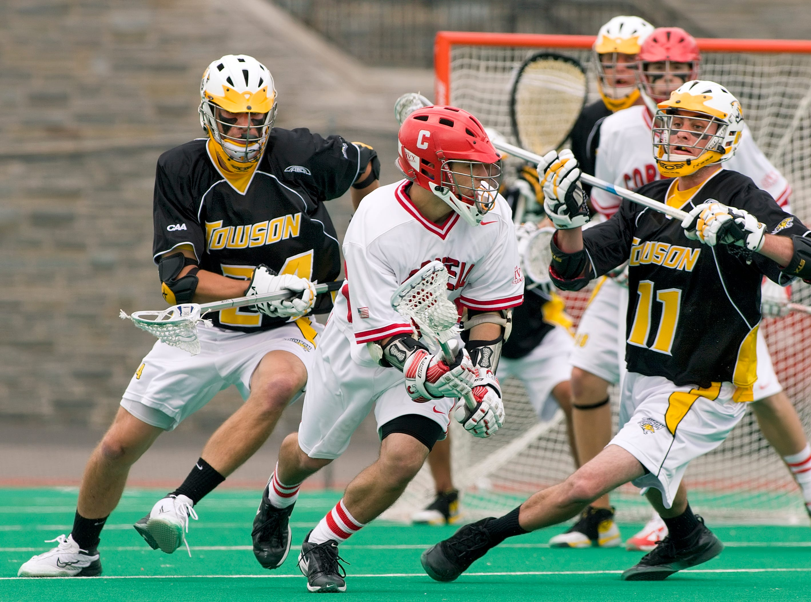 2007: Cornell's John Espey looks for an opening as Towson's Fred Lee, left, and Matt Latonick defend during Cornell's first round victory over Towson May 12th.