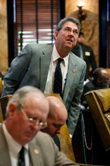 Rep. Randall Patterson, R-Biloxi, looks into the House gallery at lobbyists while lawmakers continue to vote in this April 2, 2013, photo.