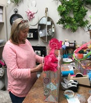 Wanda Thompson of Sand Hill wraps a gift for a customer at The Pine Cone in Ridgeland.