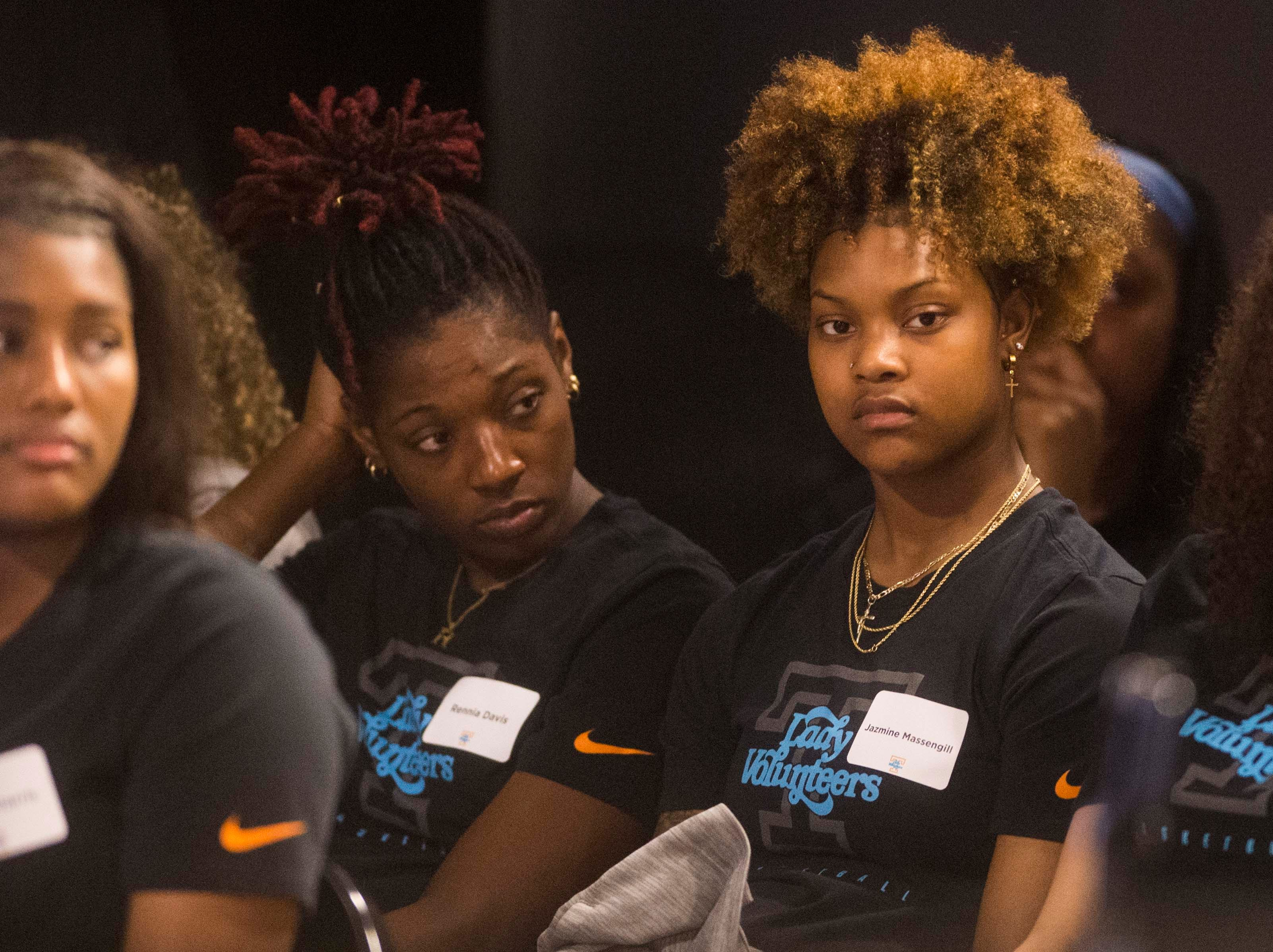 Lady Vols players Rennia Davis, left, and Jazmine Massengill listen during a press conference announcing Kellie Harper as new head coach of the Lady Vols, in the Ray and Lucy Hand Studio on University of Tennessee's campus Wednesday, April 10, 2019.