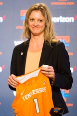Kellie Harper holds a jersey during a press conference announcing her as new head coach of the Lady Vols, in the Ray and Lucy Hand Studio on University of Tennessee's campus Wednesday, April 10, 2019.
