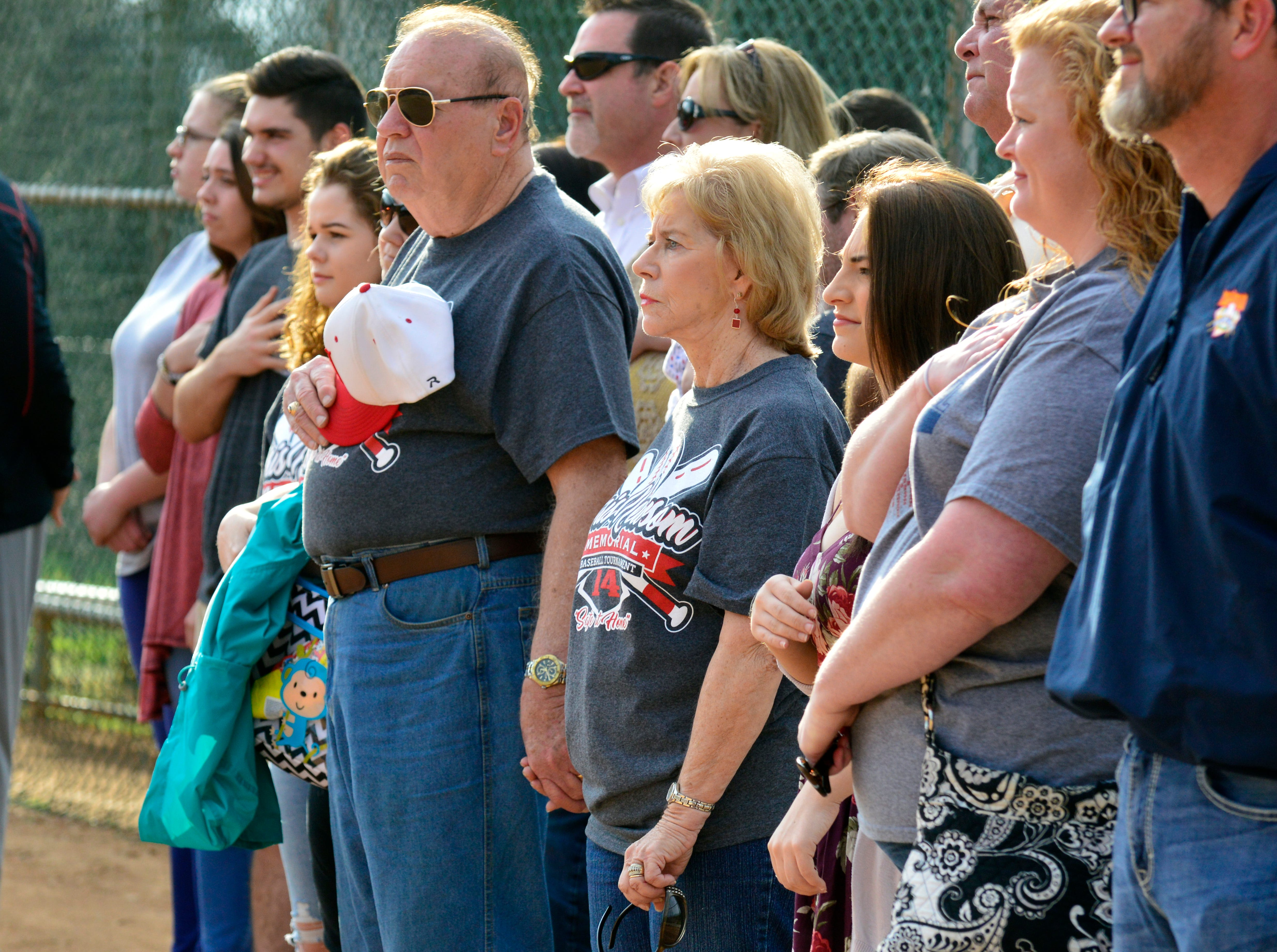 Hugh and Mary Newsom during the playing of the National Anthem at the 2018 Chris Newsom Memorial Tournament at Halls Park.