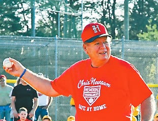 Hugh Newsom throws out the first pitch at the 2014 Chris Newsom Memorial Tournament at Halls Community Park.