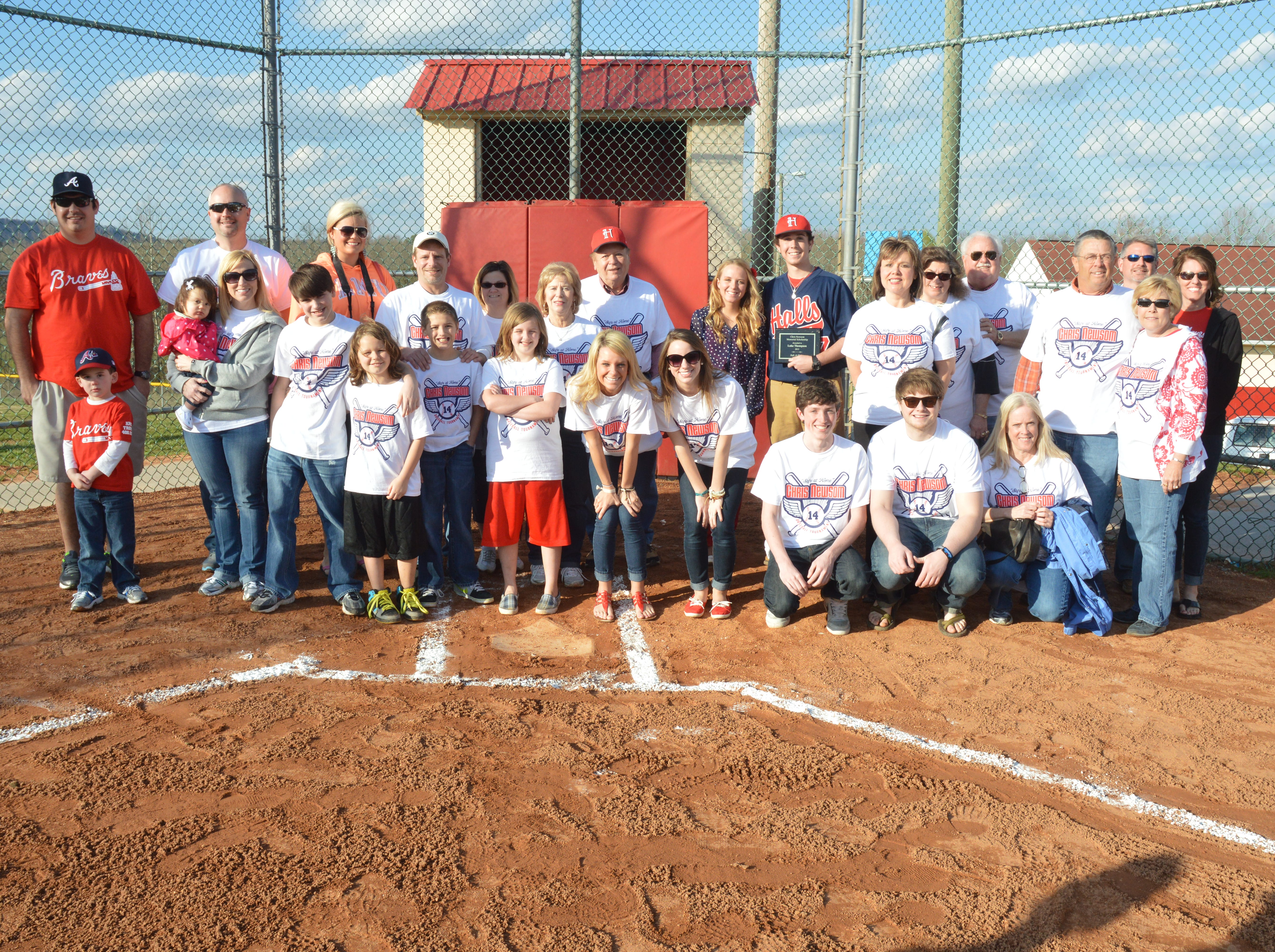 Family and friends gather with Hugh and Mary Newsom at the opening of the 2013 Chris Newsom Memorial Tournament at Halls Park.