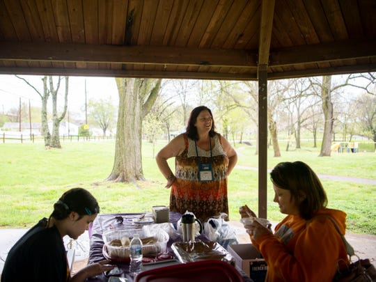 Addie Arbach, standing of Next Step Initiative, has prepared an Italian meal for visitors at West View Park on Monday, April 8, 2019.