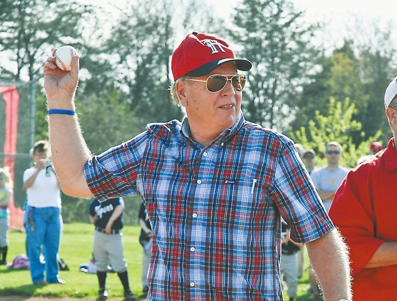 Hugh Newsom throws out the first pitch to kick off the third annual Chris Newsom Memorial Tournament in 2010 at Halls Community Park.