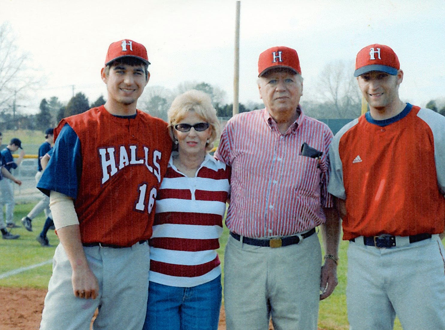 David White, Mary and Hugh Newsom and HHS assistant coach David McMahon gathered at home plate of a 2007 Halls High baseball game. The Chris Newsom Memorial Tournament was established in 2008 with scholarship money being distributed beginning in 2009. The Newsoms were presented with a plaque that was placed on a building at the HHS ball field prior to the first pitch of this game in March, 2007.