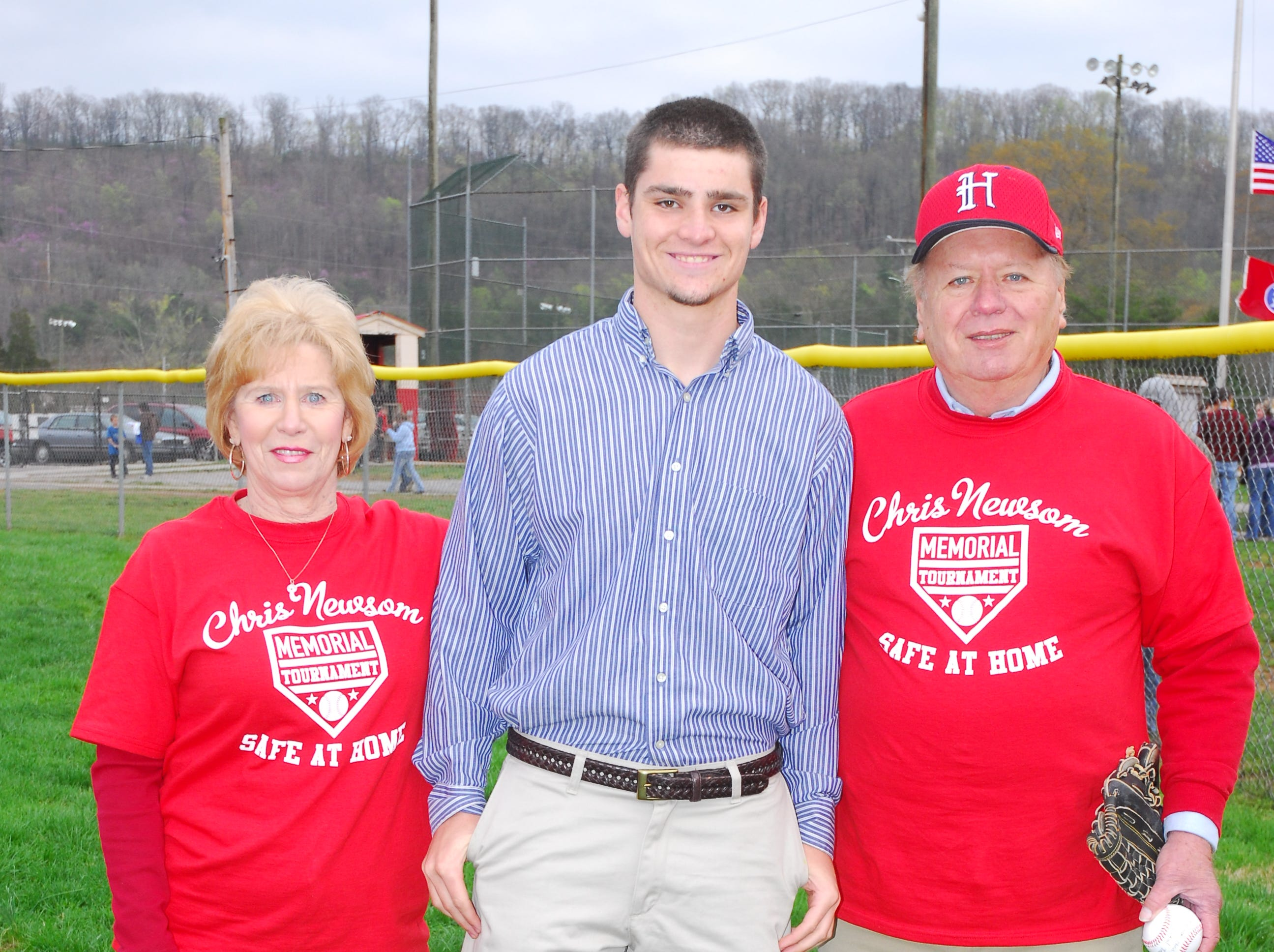 Taylor Babcock, center, was the first recipient of the Chris Newsom scholarship in 2009. He is pictured with Mary and Hugh Newsom during the opening ceremonies of the 2011 tournament.