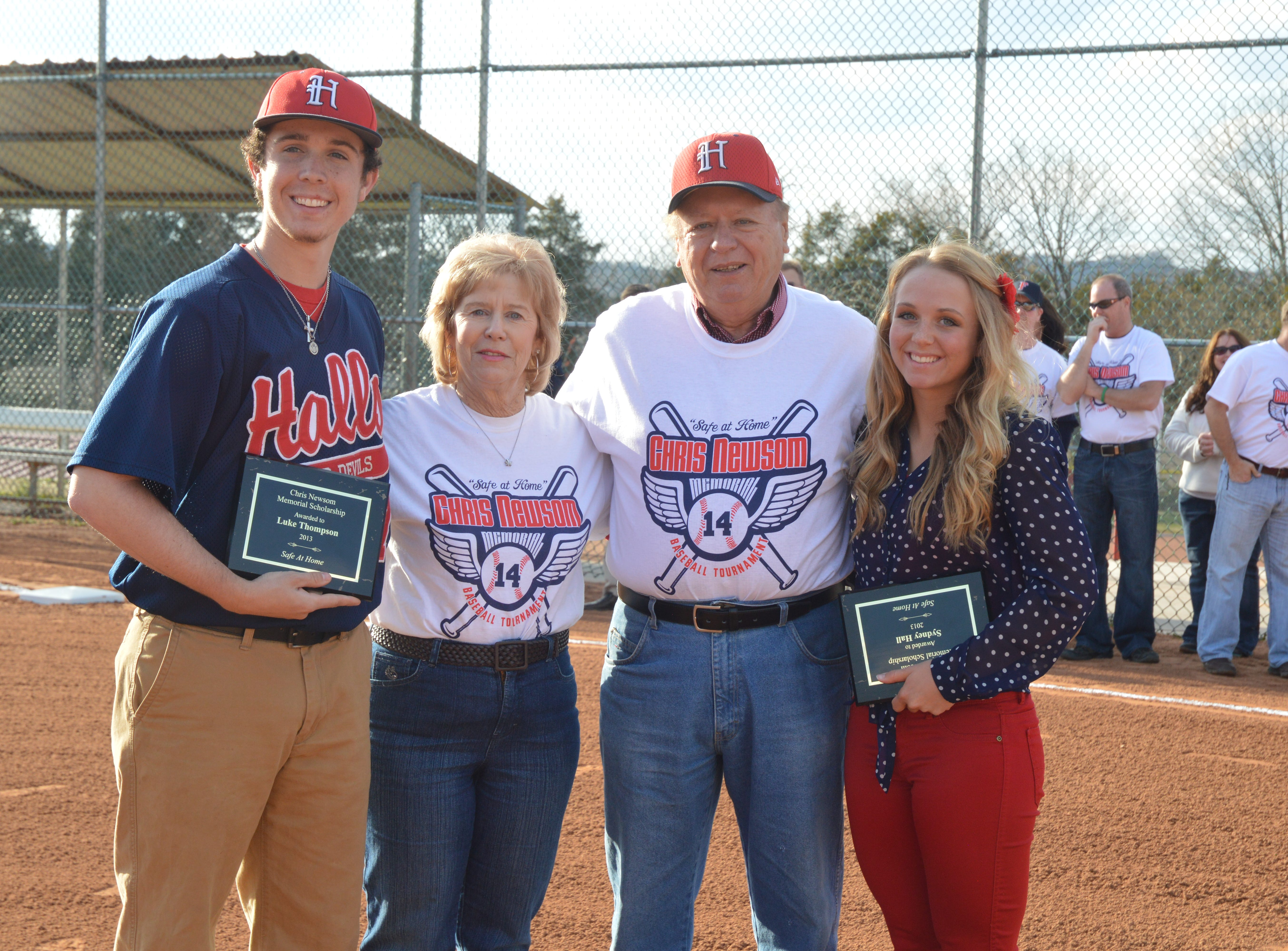 Luke Thompson, left, and Sydney Hall were honored as the 2013 Chris Newsom scholarship winners. They are pictured with Hugh and Mary Newsom.