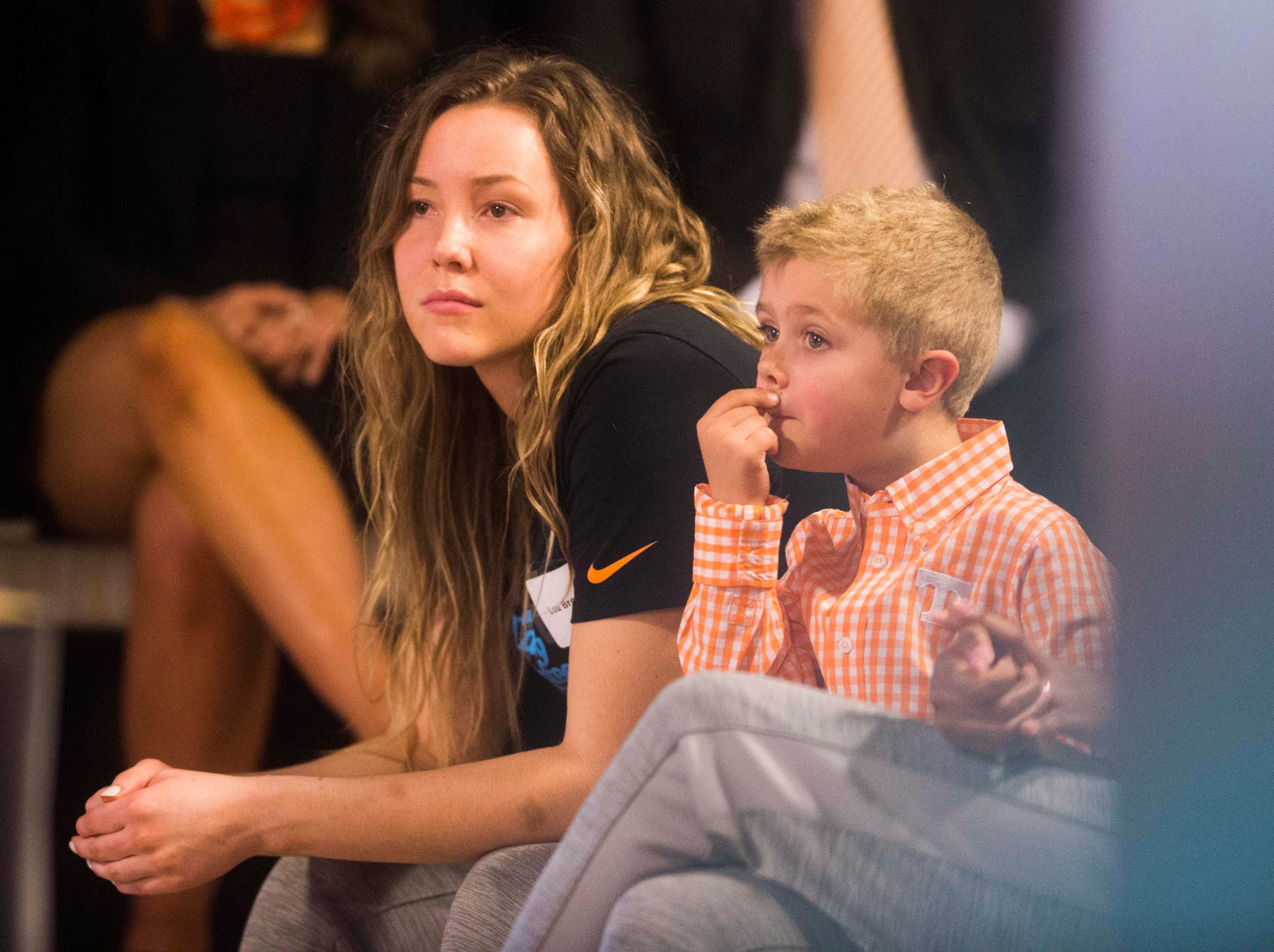 Lady Vols player Lou Brown sits next to Kellie Harper's son Jackson during a press conference announcing Harper as new head coach of the Lady Vols, in the Ray and Lucy Hand Studio on University of Tennessee's campus Wednesday, April 10, 2019.