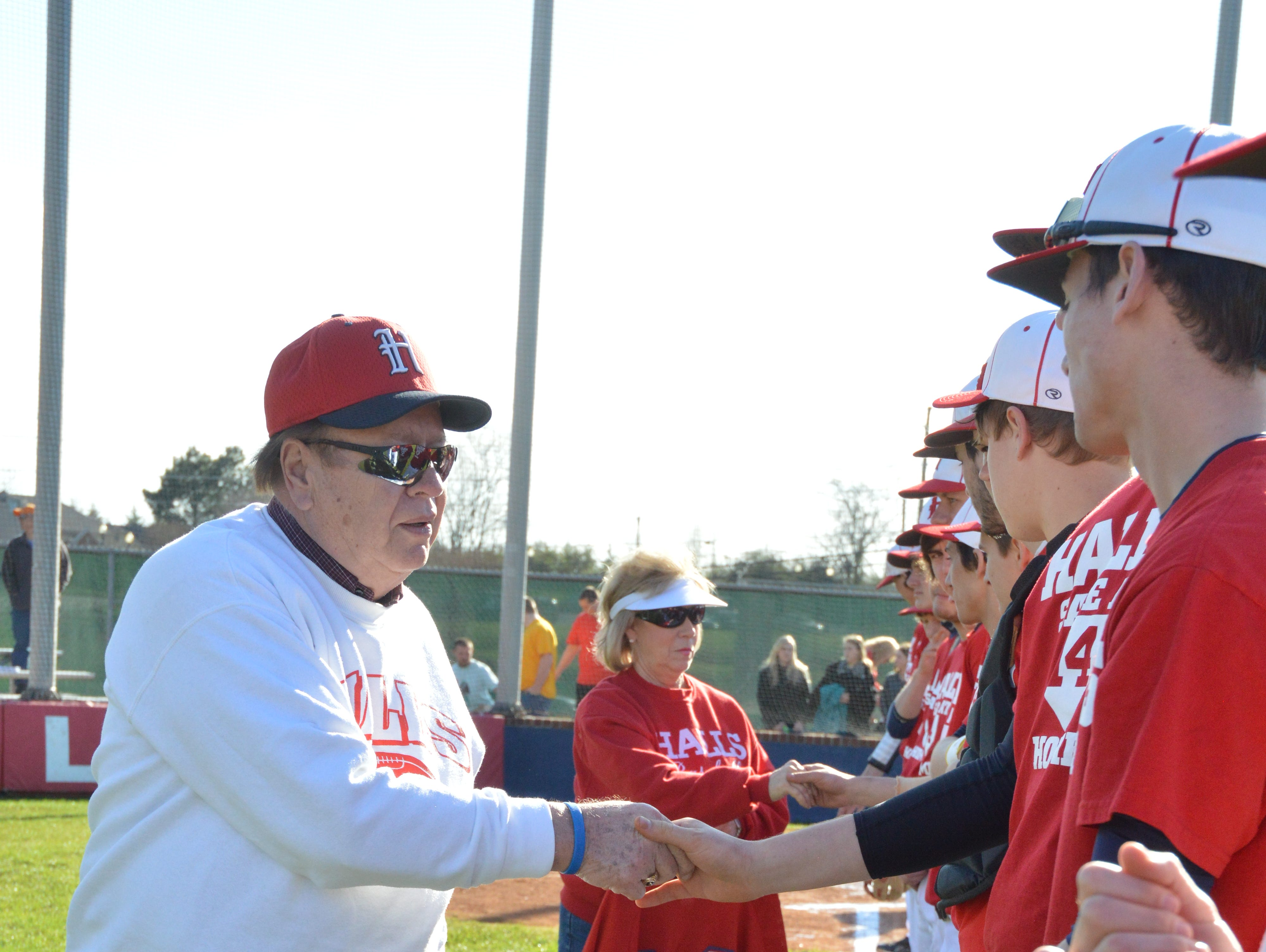 Hugh Newsom shakes hands with the Halls High baseball team prior to a game in 2013 against Central. Both teams honored Chris Newsom by wearing special jerseys.