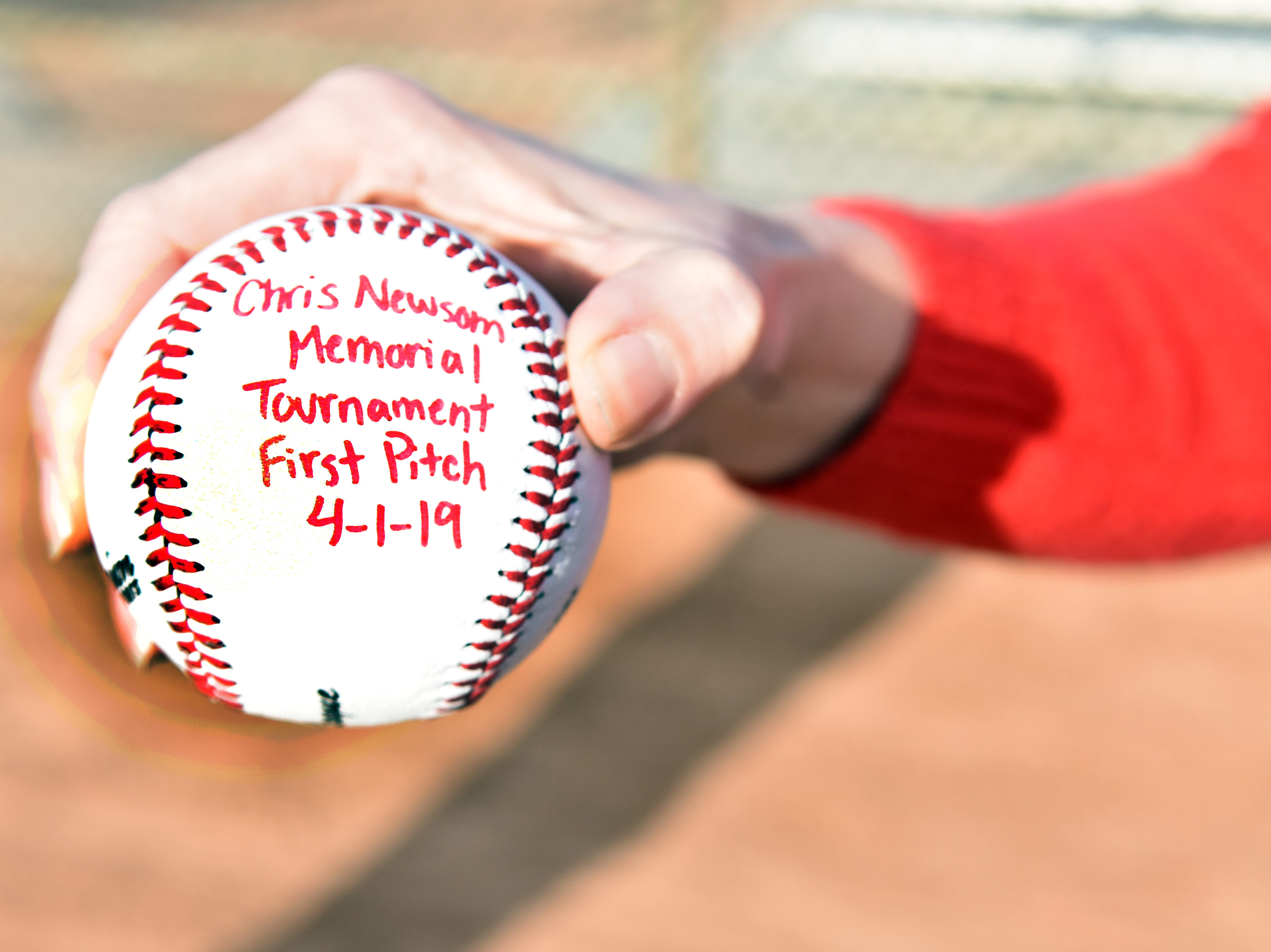 Scholarship recipients at the Chris Newsom Memorial Tournament receive an official dated baseball from the event.