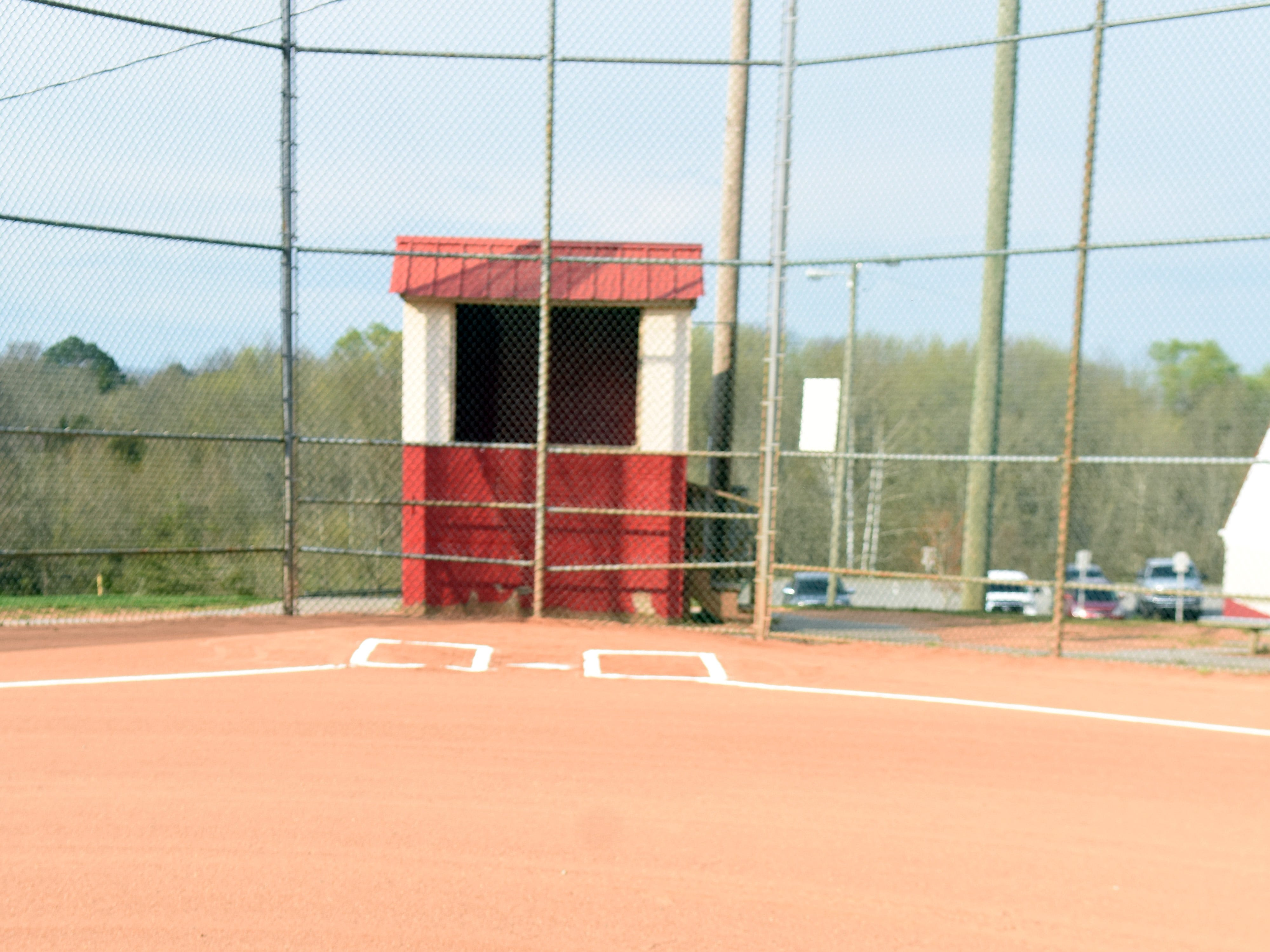Chris Newsom's jersey number from Halls High, #14, is written in chalk near the pitcher's mound of a Halls Community Park baseball field during the annual memorial tournament.