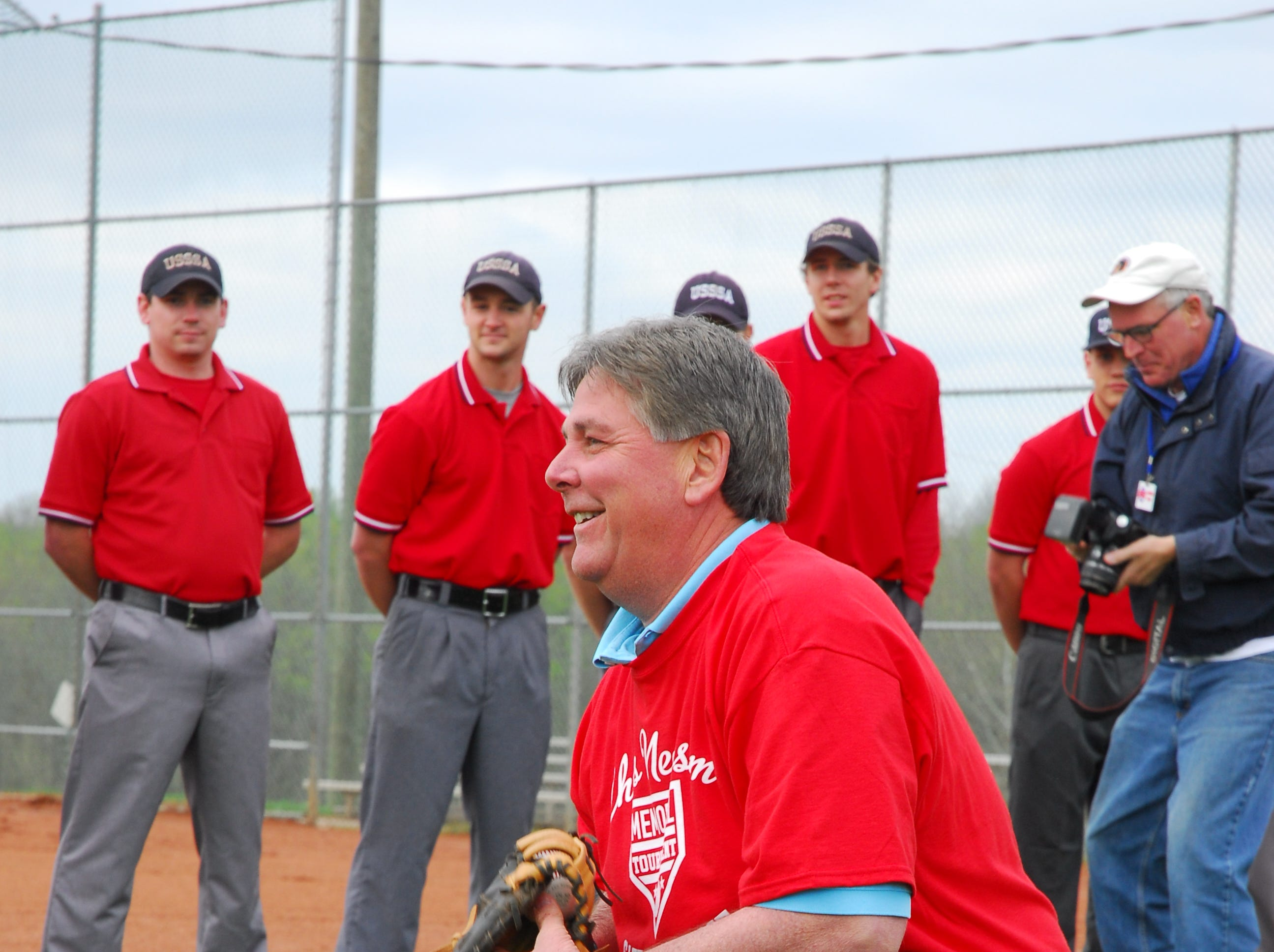 Sheriff JJ Jones served as catcher for Hugh Newsom, who threw out the first pitch of the 2011 Chris Newsom Memorial Tournament at Halls Park.