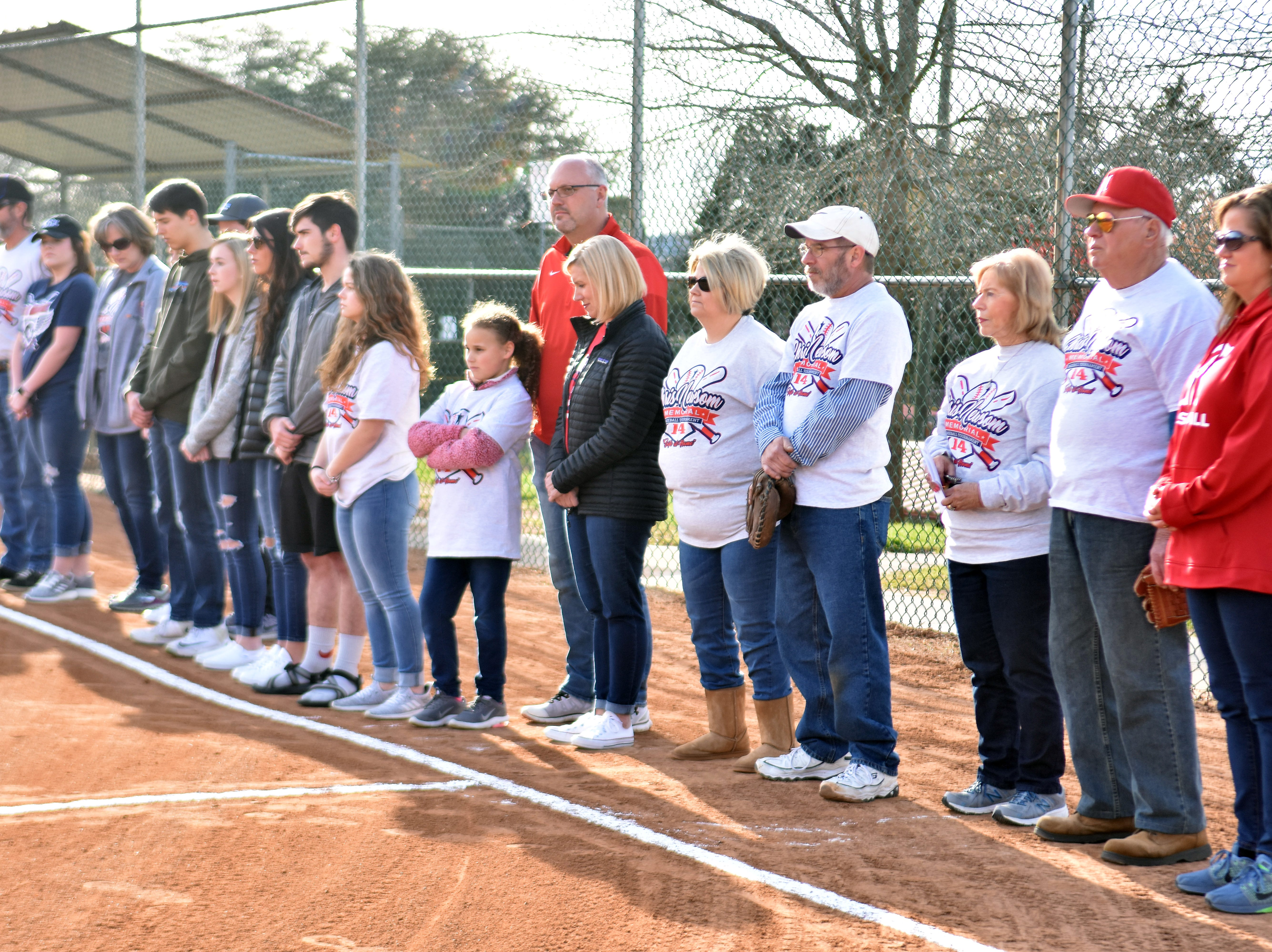 The Newsom family gathered along the first base line at Halls Community Park for the opening of the 2019 Chris Newsom Memorial Tournament.