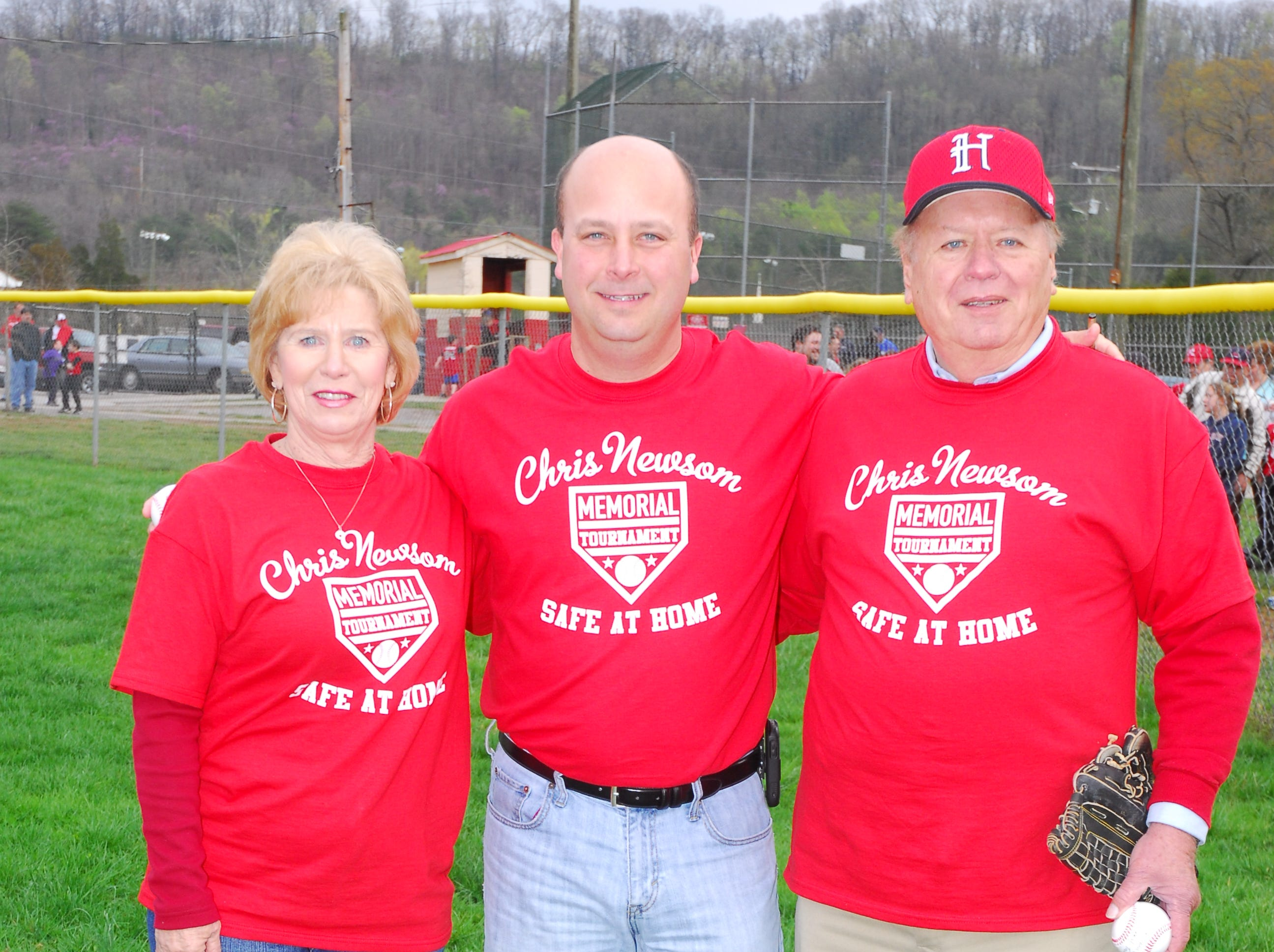 Mary and Hugh Newsom with Halls Park president Todd Cook, center, in 2011.