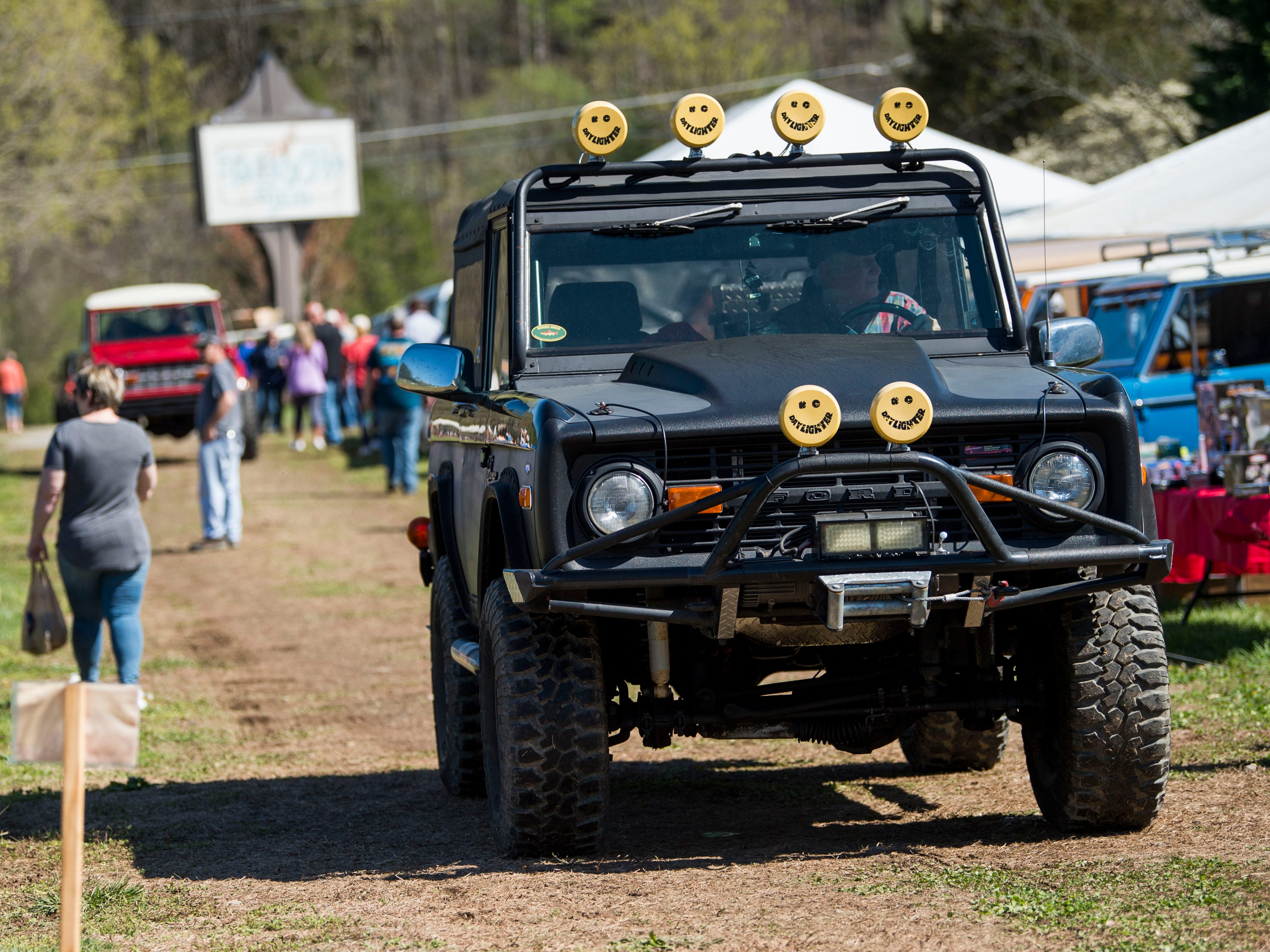 A Ford Bronco makes its way to its spot at the Bronco Super Celebration event held at Tally Ho Inn in Townsend, Tenn. Between 500 and 600 Broncos are expected at the event, which will run from April 10, 2019, to April 13, 2019.
