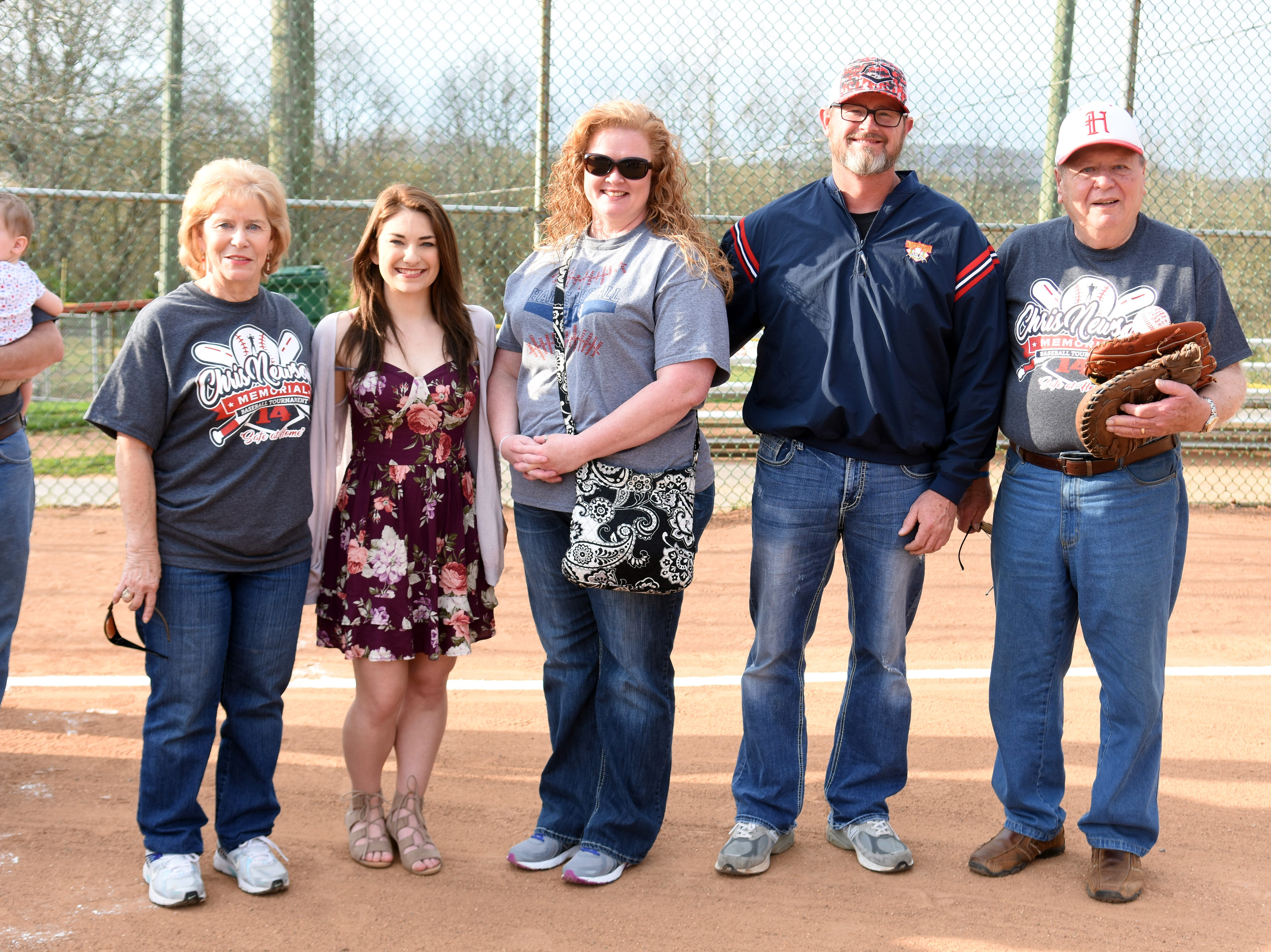 Mary and Hugh Newsom presented scholarships to Brianna Yanniello and Enic Brock at the 2018 Chris Newsom Memorial Tournament. Enic's parents accepted his award as he was playing baseball for the Halls Red Devils during the opening of the  tournament.