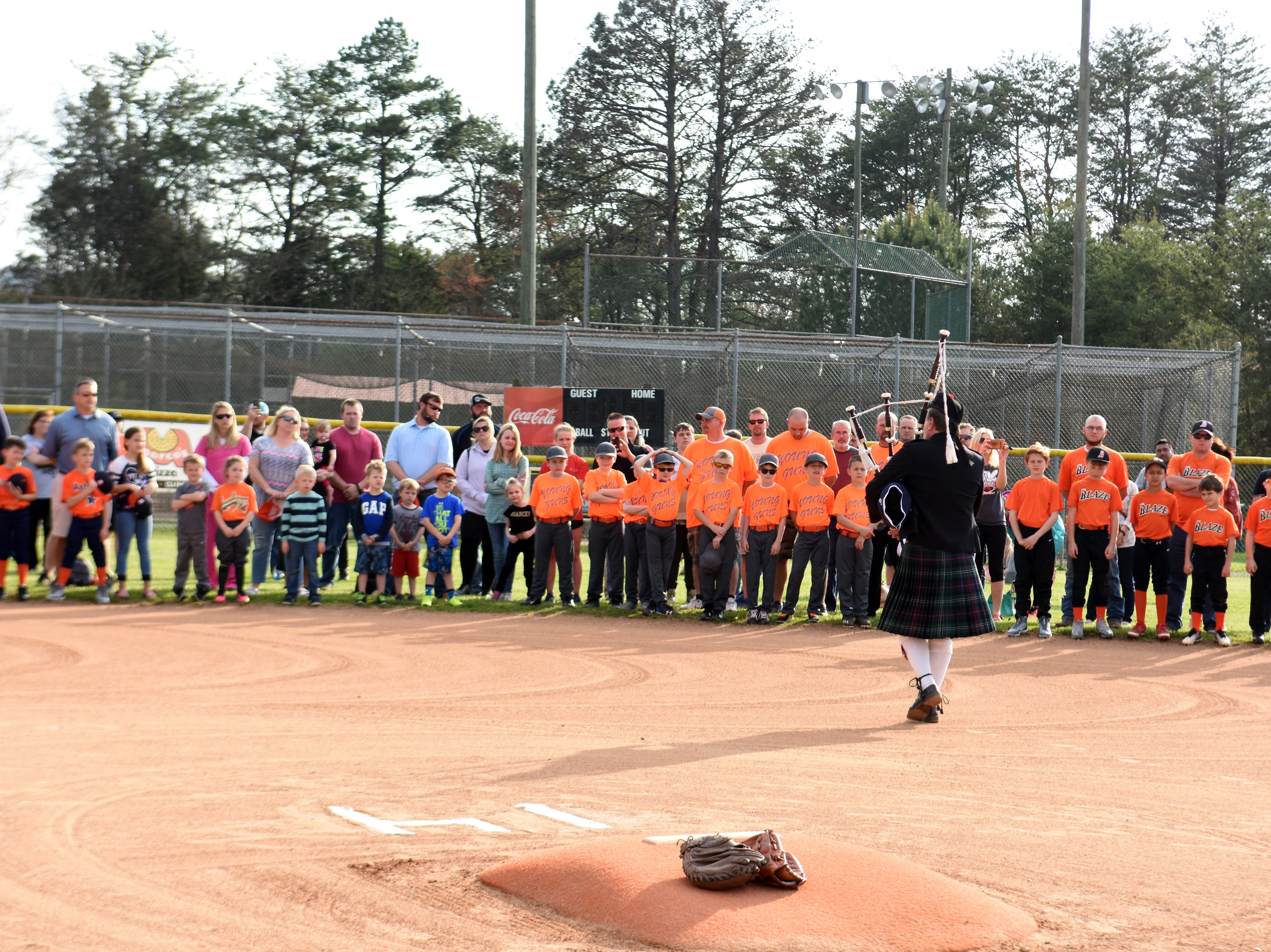 """John Rose plays """"Amazing Grace"""" on the bagpipes at the opening ceremony of the Chris Newsom Memorial Tournament at Halls Park."""