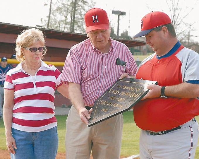 Mary and Hugh Newsom are presented a plaque by Halls High baseball coach Doug Polston in March, 2007. The place was placed inside the Halls ball field to remember Chris Newsom.