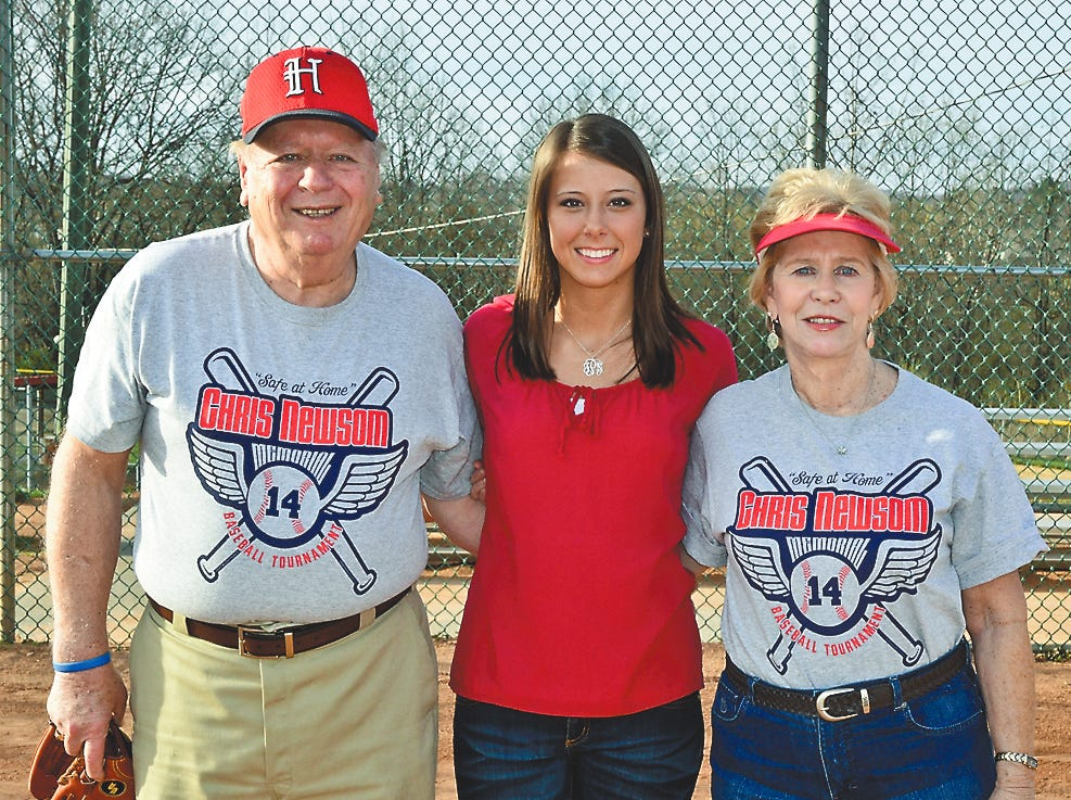Hugh and Mary Newsom with HHS senior Jenna Phillips, center, one of the 2014 Chris Newsom Scholarship winners.