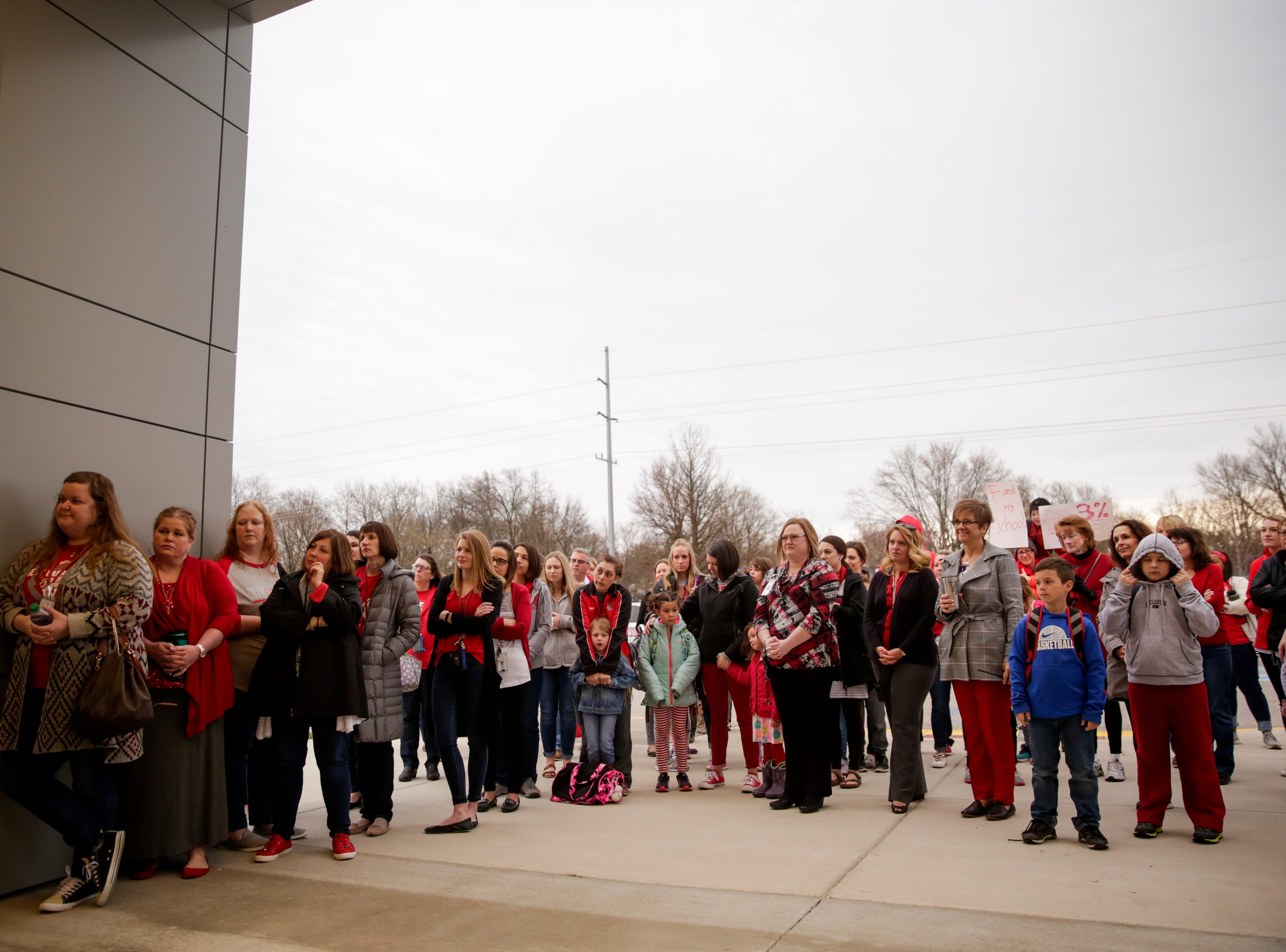 Teachers and community members listen as state Rep. Chris Campbell, D-West Lafayette, speak, Wednesday, April 10, 2019, at Cumberland Elementary School in West Lafayette. Greater Lafayette teachers and community members gathered outside schools before walking in to demand teacher salary raises.(Nikos Frazier   Journal & Courier)