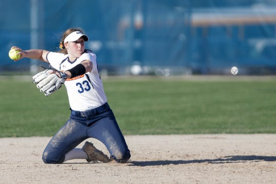 Harrison shortstop Anna Henderson (33) recovers to throw to first during the third inning of a high school softball game, Tuesday, April 9, 2019, at Harrison High School in Lafayette. Harrison won, 8-5.(Nikos Frazier | Journal & Courier)