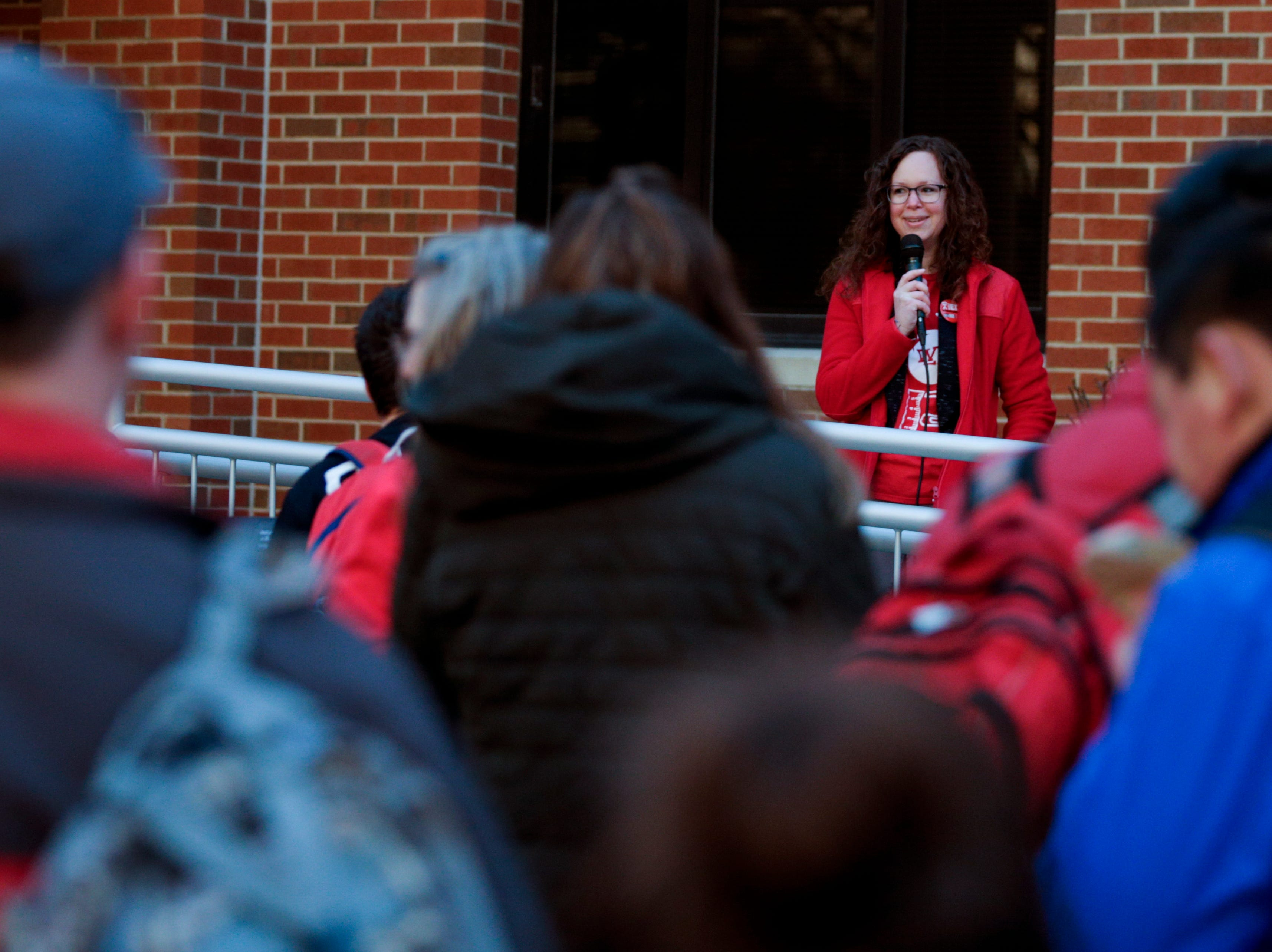 Andi Hipsher, West Lafayette Educators Association co-president, speaks during a gathering of teachers to demand teacher salary raises, Wednesday, April 10, 2019, at West Lafayette Jr./Sr. High School in West Lafayette. Greater Lafayette teachers and community members gathered outside schools before walking in to demand teacher salary raises.(Nikos Frazier   Journal & Courier)