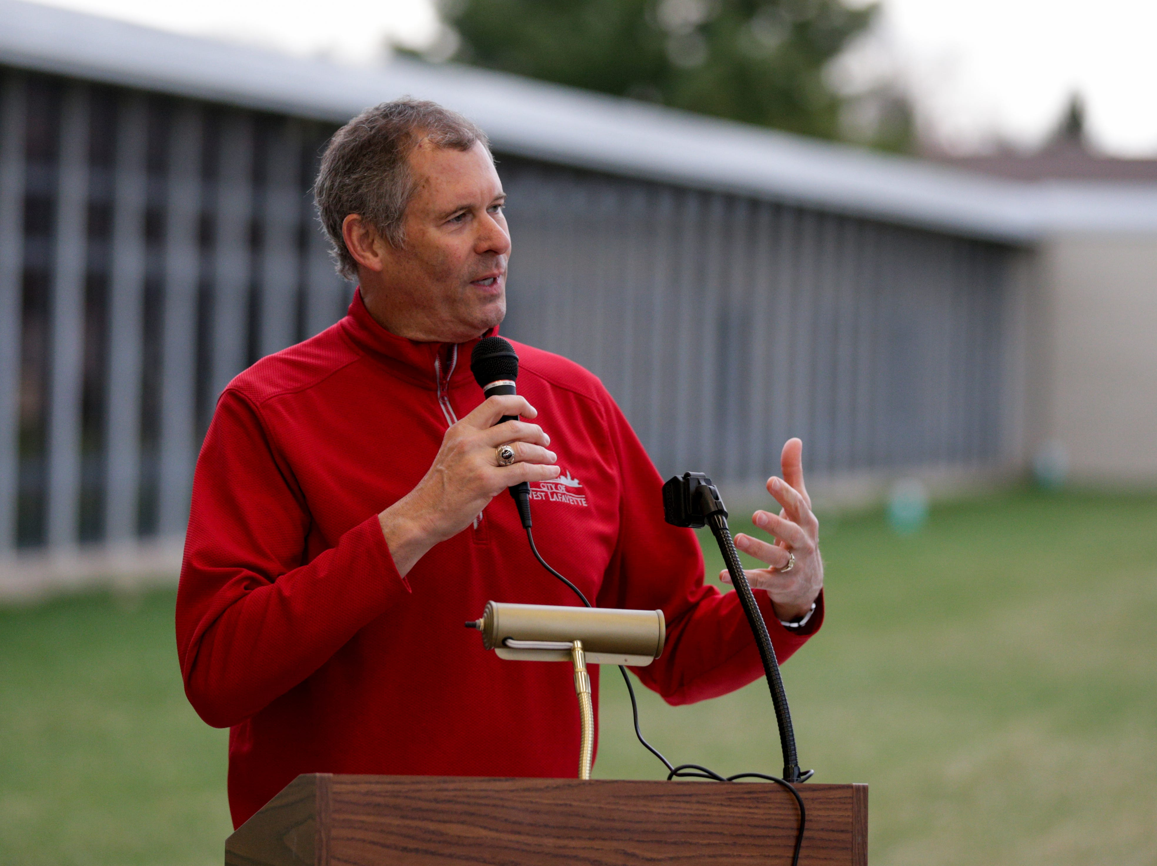 West Lafayette Mayor John Dennis speaks to a gathering of teachers, Wednesday, April 10, 2019, at Cumberland Elementary School in West Lafayette. Greater Lafayette teachers and community members gathered outside schools before walking in to demand teacher salary raises.(Nikos Frazier   Journal & Courier)
