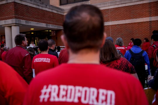 Community members and teachers gather outside of West Lafayette Jr./Sr. High School before walking into school to demand teacher salary raises, Wednesday, April 10, 2019, in West Lafayette. Greater Lafayette teachers and community members gathered outside schools before walking in to demand teacher salary raises.