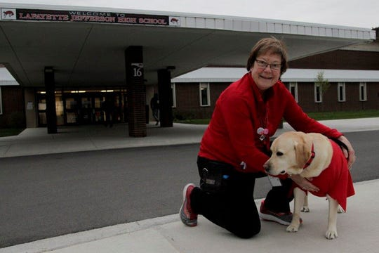 Gail Gripe and her dog, Sophie, pose for a photo, Wednesday, April 10, 2019, outside of Lafayette Jefferson High and Tecumseh Middle School in Lafayette.