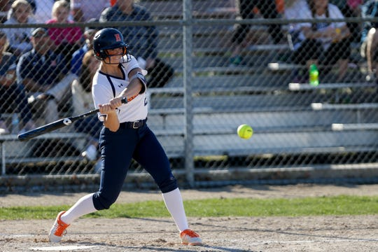 Harrison pitcher Abbott Badgley (20) swings during the first inning of a high school softball game, Tuesday, April 9, 2019, at Harrison High School in Lafayette. Harrison won, 8-5.  (Nikos Frazier   Journal & Courier)