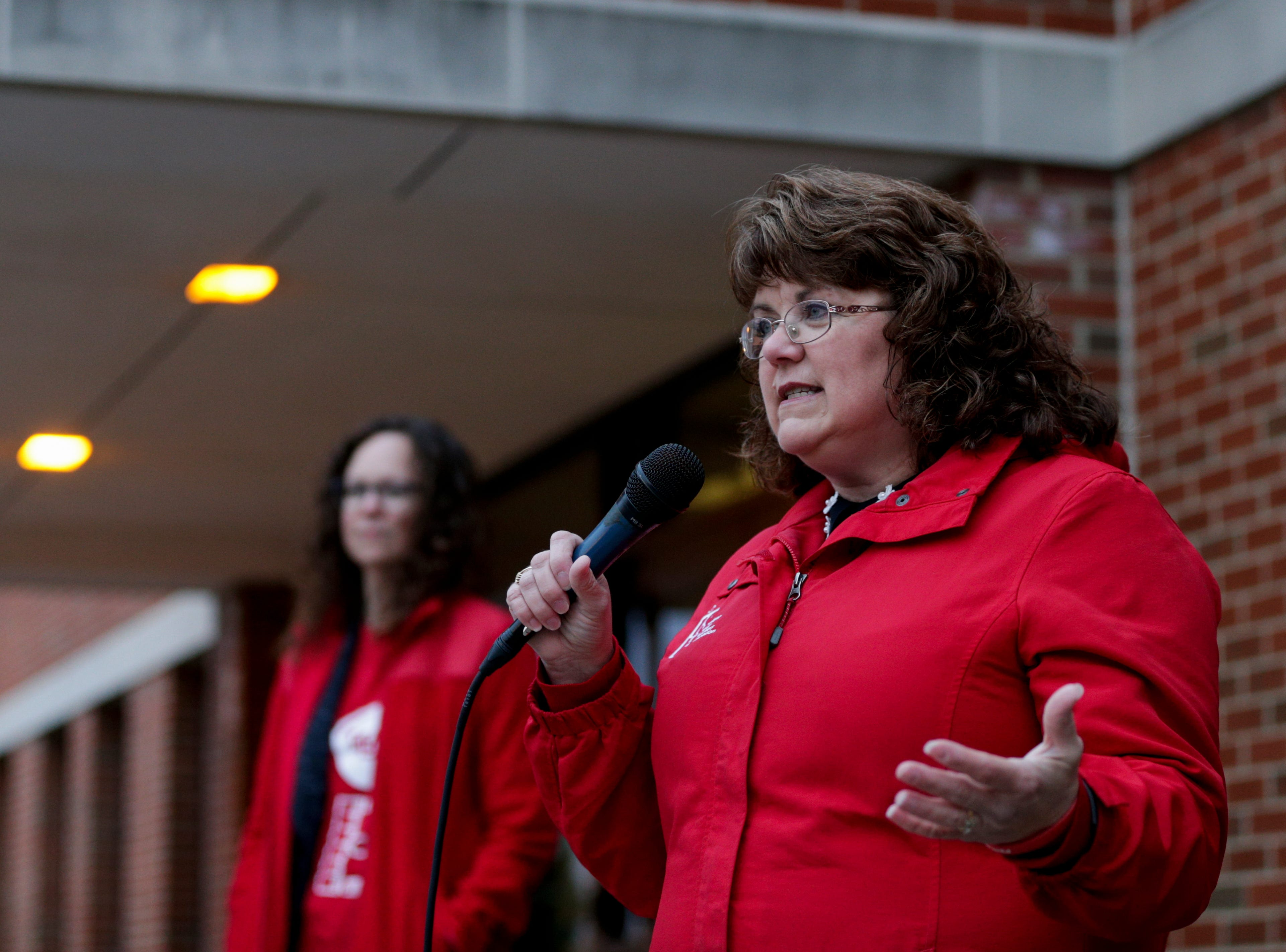 Teresa Meredith, Indiana state teachers association president, speaks to teachers and community members during a gathering outside of West Lafayette Jr./Sr. High School, Wednesday, April 10, 2019, in West Lafayette. Greater Lafayette teachers and community members gathered outside schools before walking in to demand teacher salary raises.(Nikos Frazier   Journal & Courier)