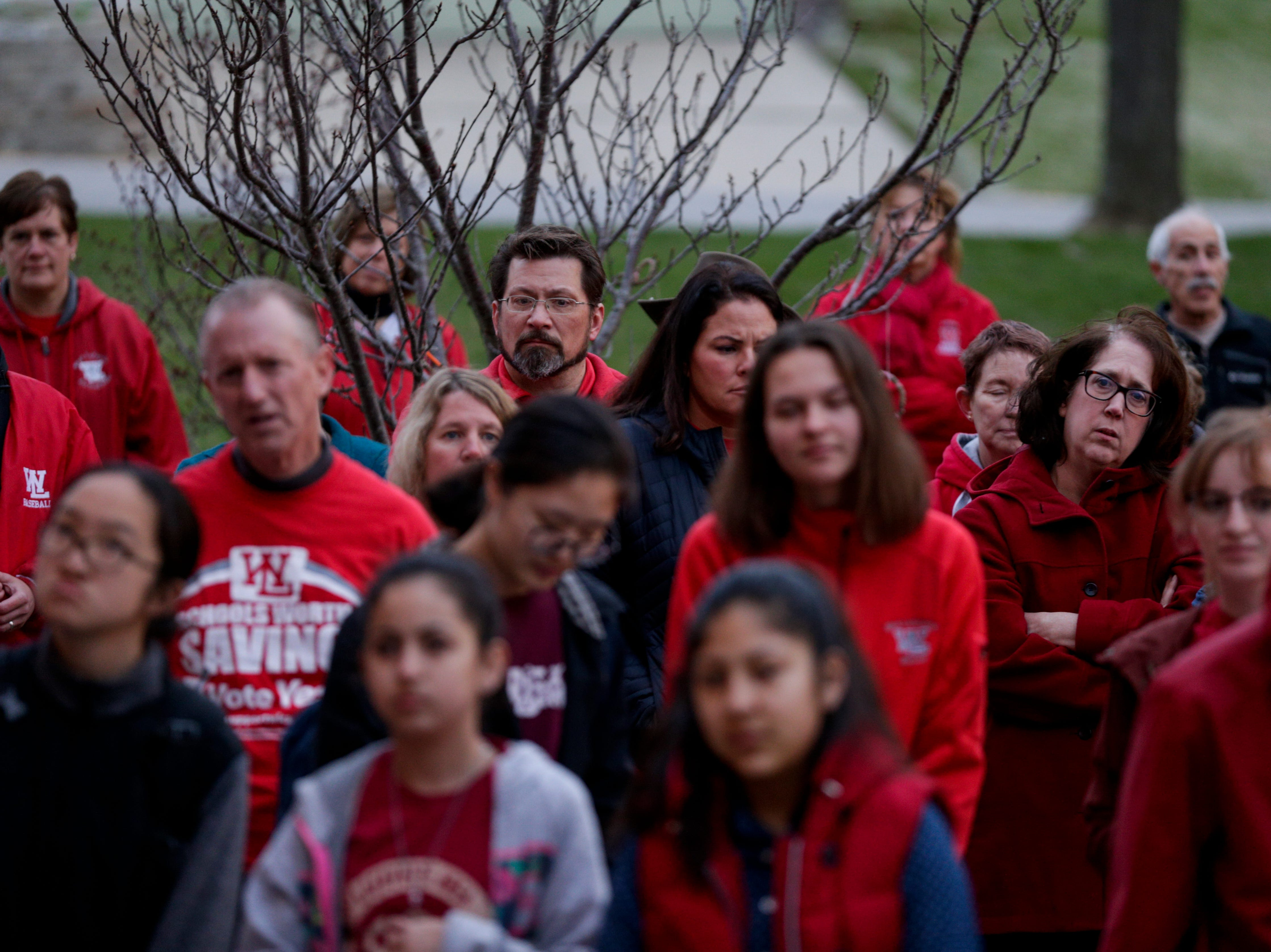 Teachers and community members listen to Dr. Rocky D. Killion, West Lafayette superintendent, speak during a gathering of teachers outside of West Lafayette Jr./Sr. High School, Wednesday, April 10, 2019, in West Lafayette. Greater Lafayette teachers and community members gathered outside schools before walking in to demand teacher salary raises.(Nikos Frazier   Journal & Courier)